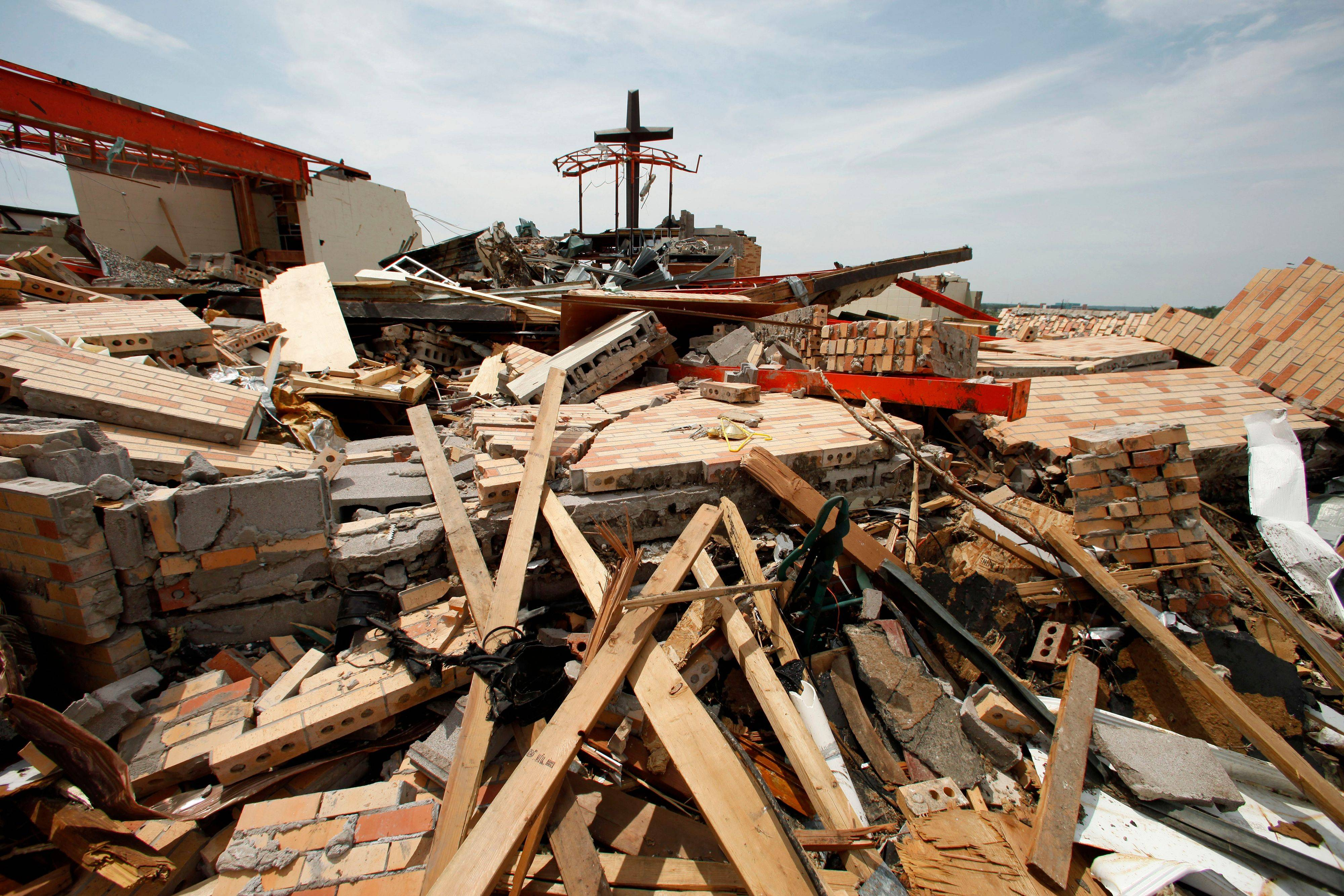 On May 30, damage is seen in a devastated Joplin, Mo., neighborhood.