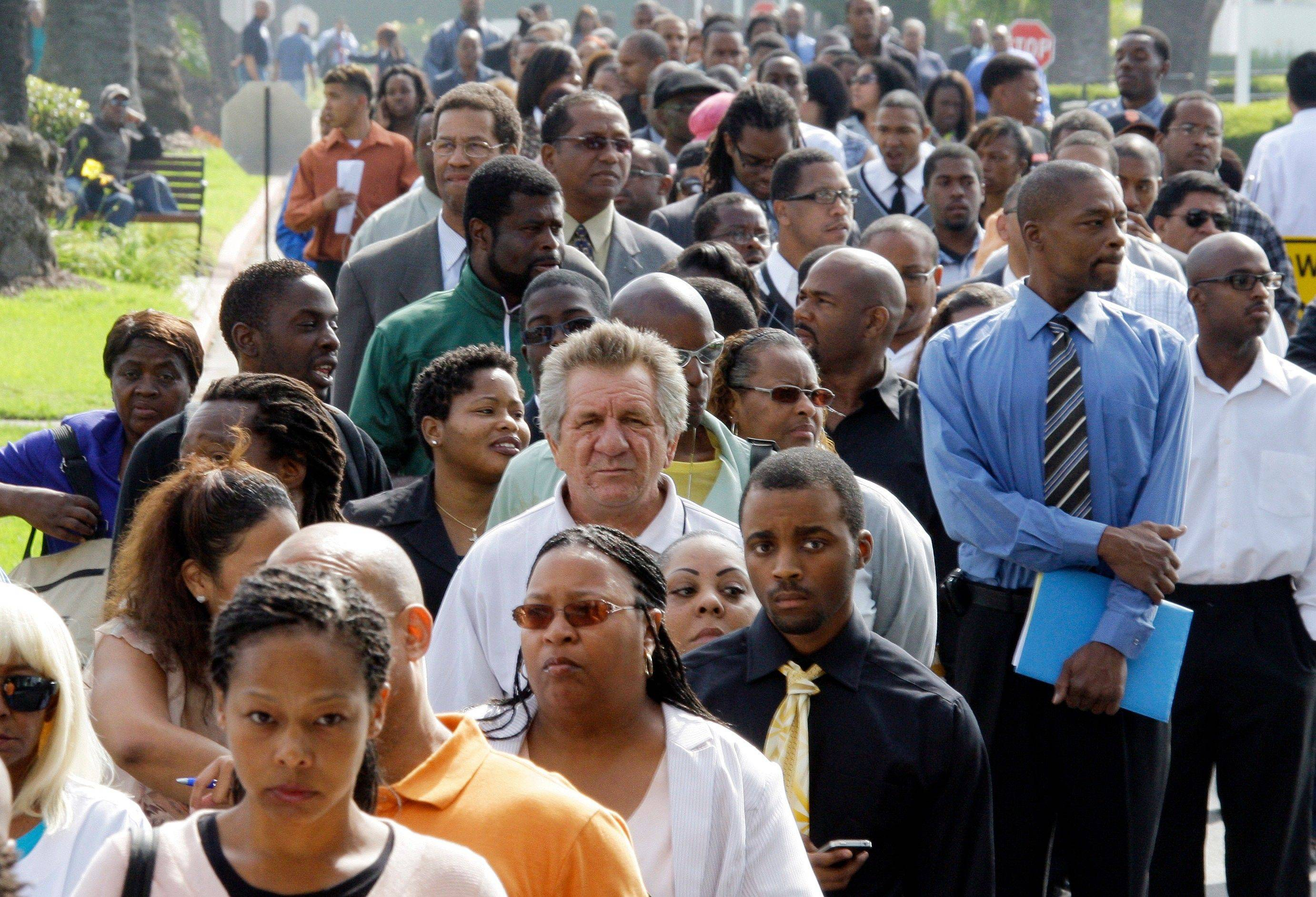 On Aug. 31, crowds of job-seekers wait to enter a job fair at Crenshaw Christian Center in South Los Angeles. Most economists expect growth of between 1.5 percent and 2 percent in the final two quarters. Though an improvement, it wouldn�t be enough to lower the unemployment rate.