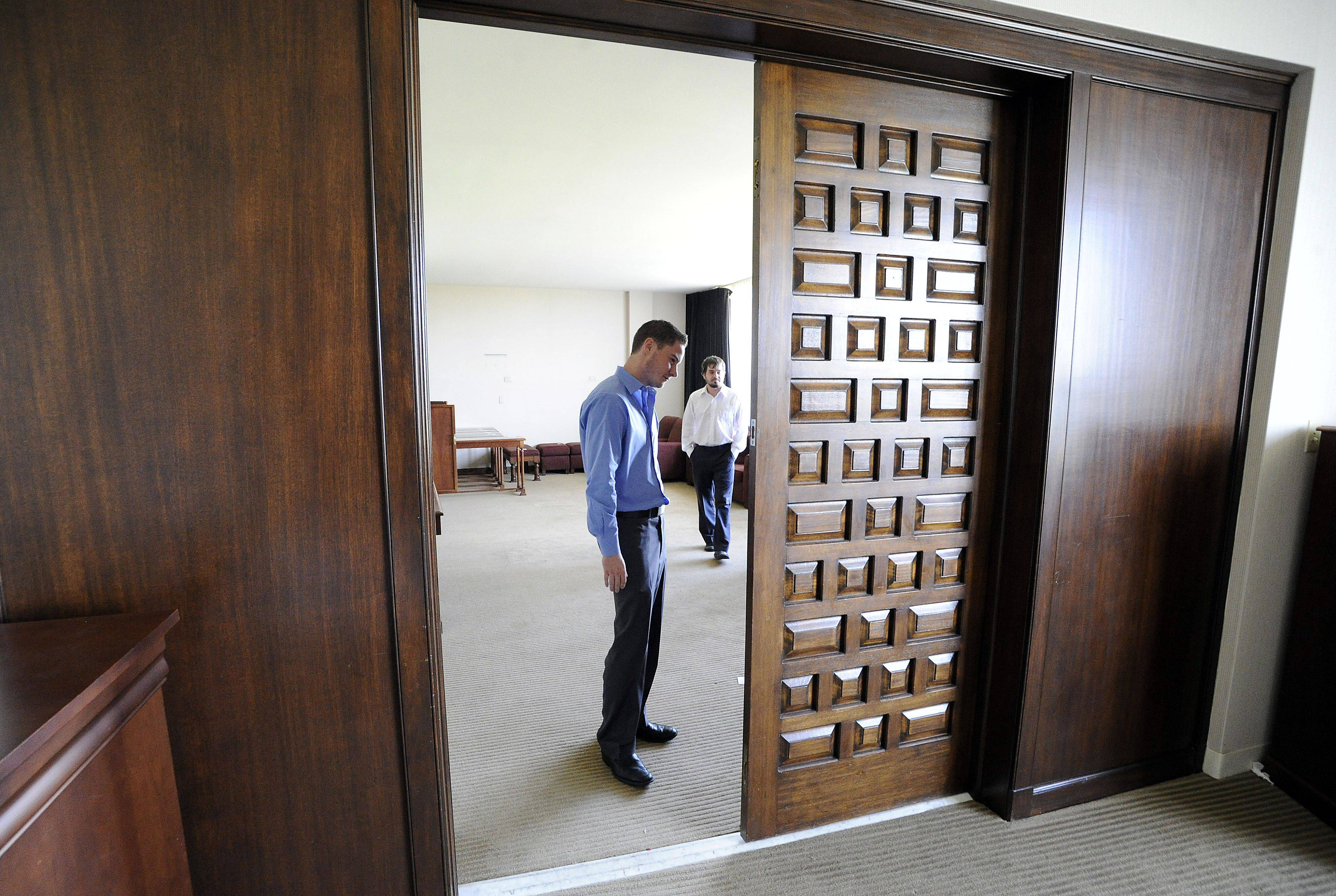 Brandon Smith of Prospect Heights looks over the doors from the Elvis Presley suite, which Elvis had specially made, at the liquidation sale at the former Sheraton Chicago Northwest Hotel in Arlington Heights.