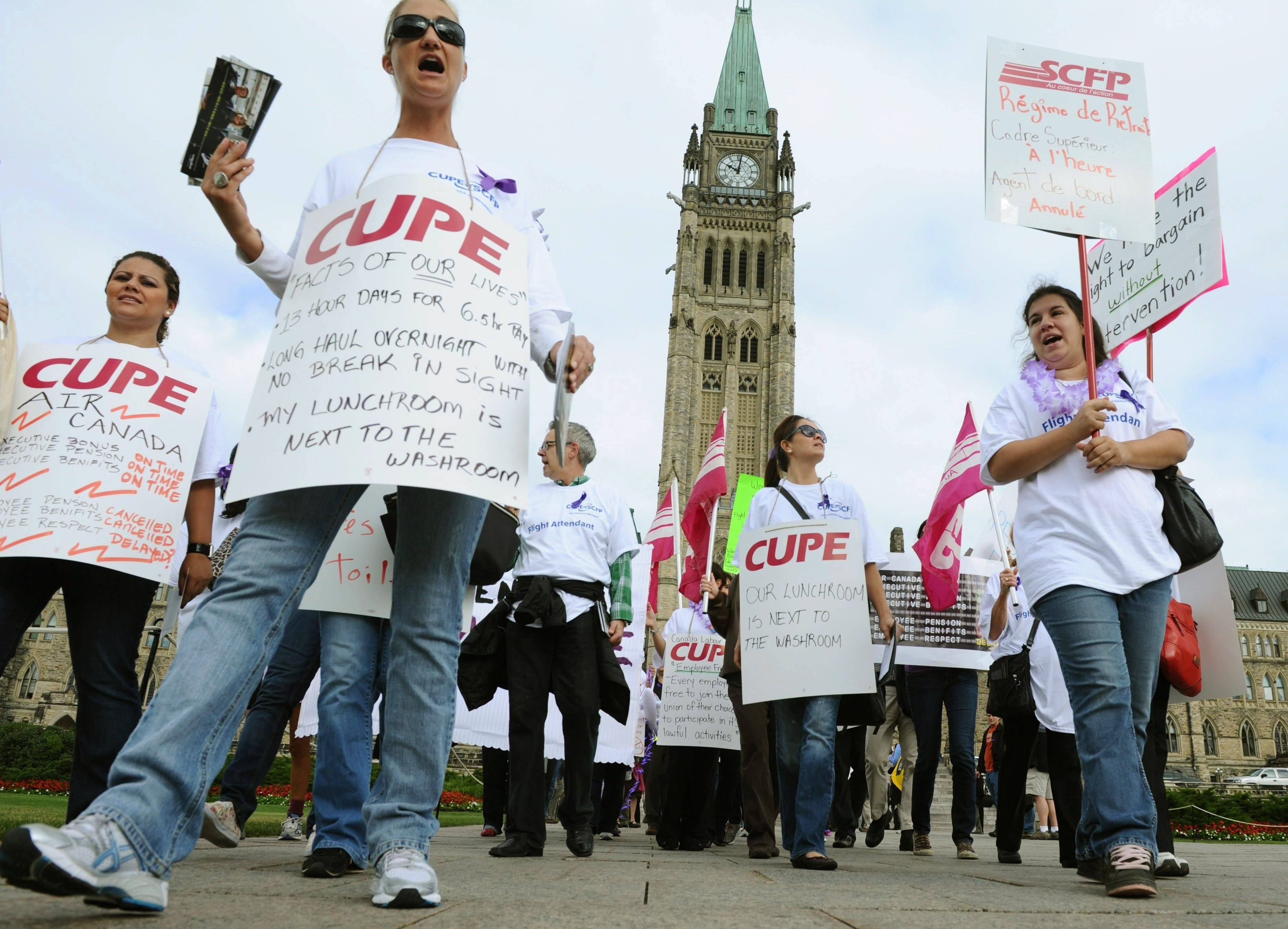 Air Canada employees rally Tuesday on Parliament Hill in Ottawa. Talks between Air Canada and its flight attendants broke off late Monday without an agreement, but an airline spokesman says negotiations will resume, in hopes of avoiding a strike, just after midnight tonight.