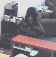 Surveillance photo of the robbery of West Suburban Bank, 895 E. Geneva Road in Carol Stream, on Monday.