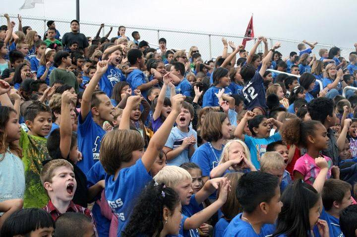 Children from Jane Addams Elementary School in Palatine cheer at last year�s inaugural �No Excuses University� assembly at Palatine High School.