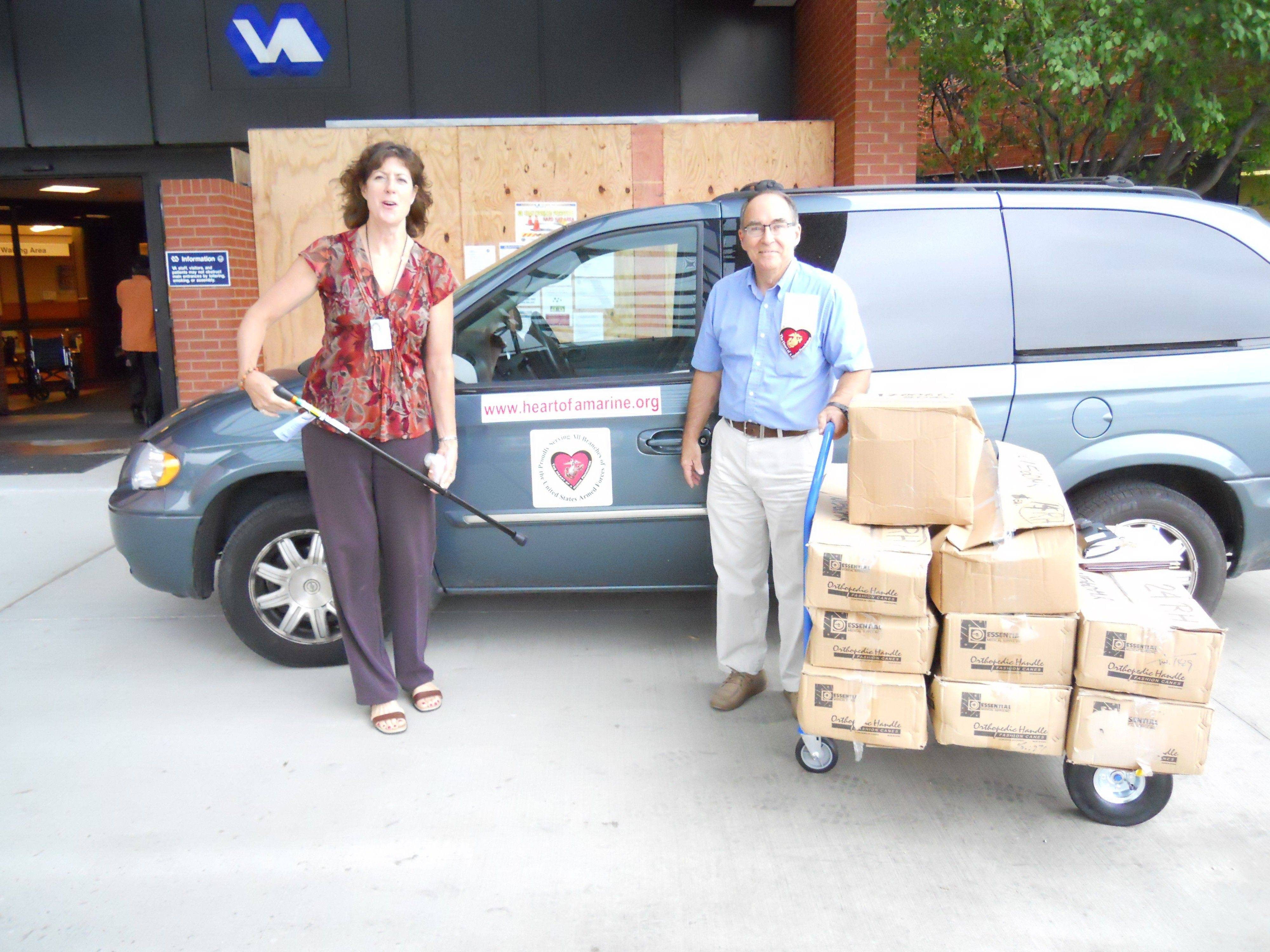 Roy Frank, co-founder of Heart Of A Marine Foundation, delivers canes to Annette Katamay at Edward Hines Jr. VA Hospital on Friday, Sept. 9.