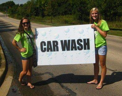 Danielle Tassi and Grace Eisenhuth advertise for the Hawthorn Woods Elite Car wash, held in Kildeer at Atrium Garden Center.