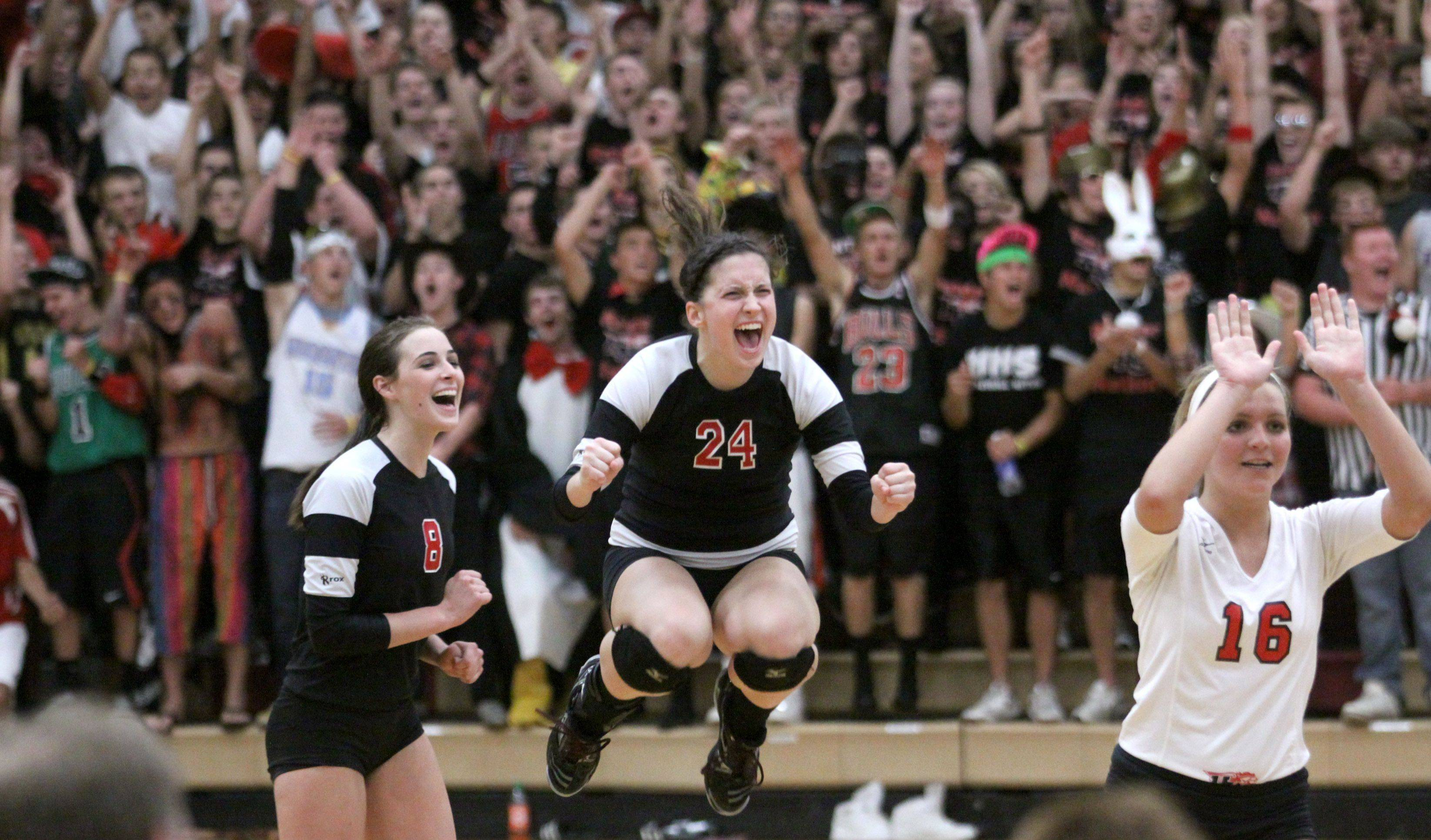 From left, Huntley�s Samantha Boesch, Elizabeth Manning, and Amy Dion celebrate a point late in their victory over Cary-Grove during Fox Valley Conference volleyball action at Huntley on Tuesday night.