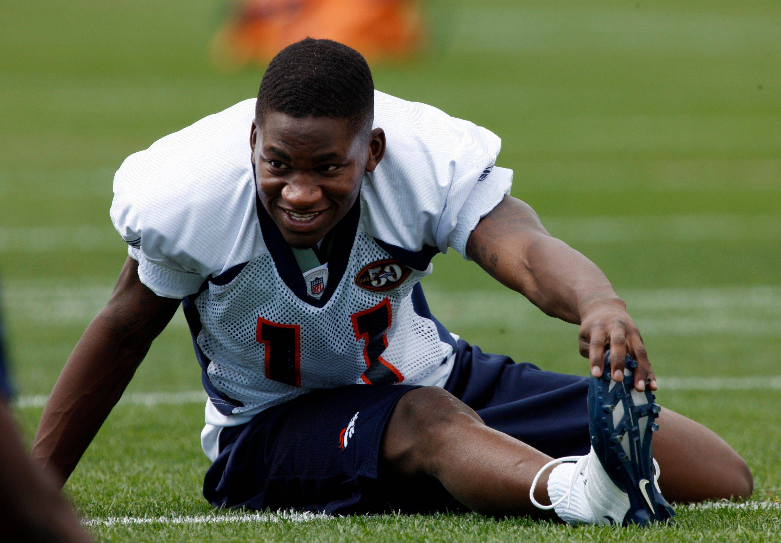 This is a July 29, 2009 file photo showing Denver Broncos rookie wide receiver Kenny McKinley stretching before drills at the team�s training camp in Englewood, Colo. The empty locker that served as a shrine is no longer there. Neither are the No. 11 helmet decals that his Broncos teammates wore in McKinley�s honor after he committed suicide last year. Tuesday, Sept. 20, 2011 marked the one-year anniversary of McKinley�s death.