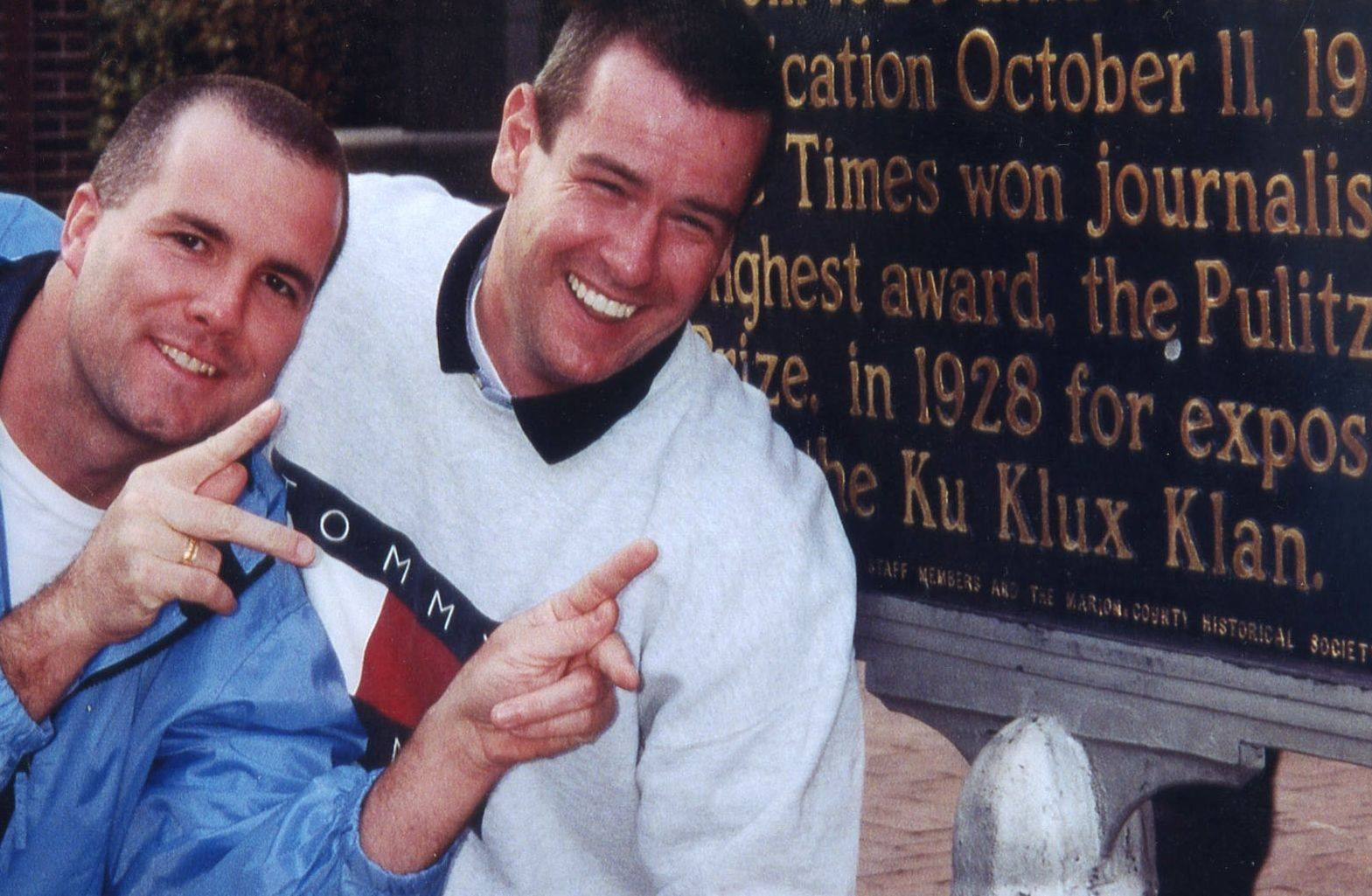 Elgin police Lt. Sean Rafferty, left, and officer Tom Wolek pose near a sign in Indianapolis that refers to the Pulitzer Prize won by the Indianapolis Times in 1928 for its work exposing the Ku Klux Klan. The photo was taken during an off-duty, social trip in the late 1990s.