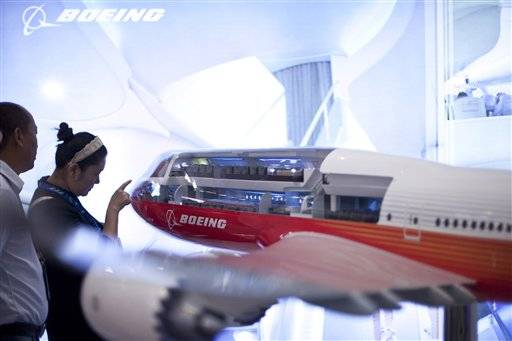 Visitors check a model of Boeing 747-8 airplane at an aviation expo in Beijing, China, Wednesday;