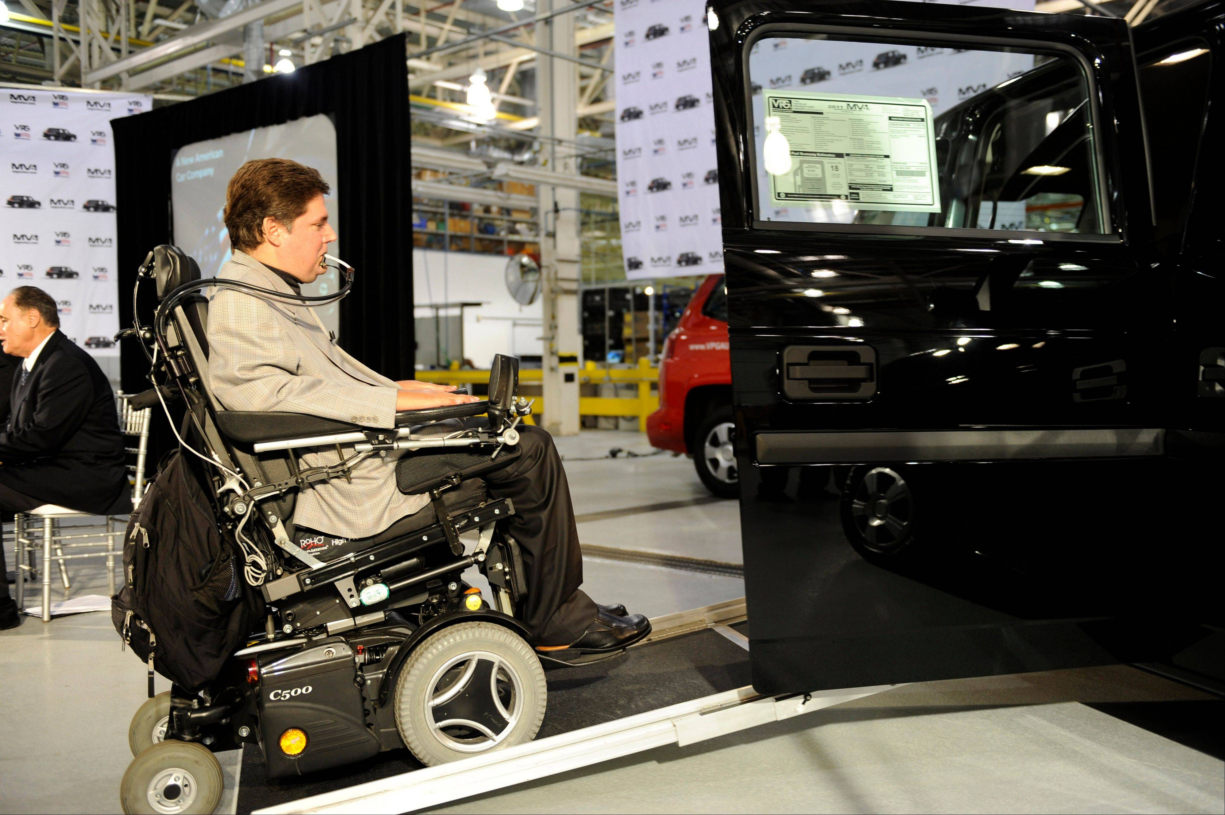 Mark Buoniconti, president of the Miami Project to Cure Paralysis and the Buoniconti Fund, rolls into the first vehicle made by the Vehicle Production Group during their launch event of the MV-1 at AM General�s Commercial Assembly Plant in Mishawaka, Ind., on Wednesday.