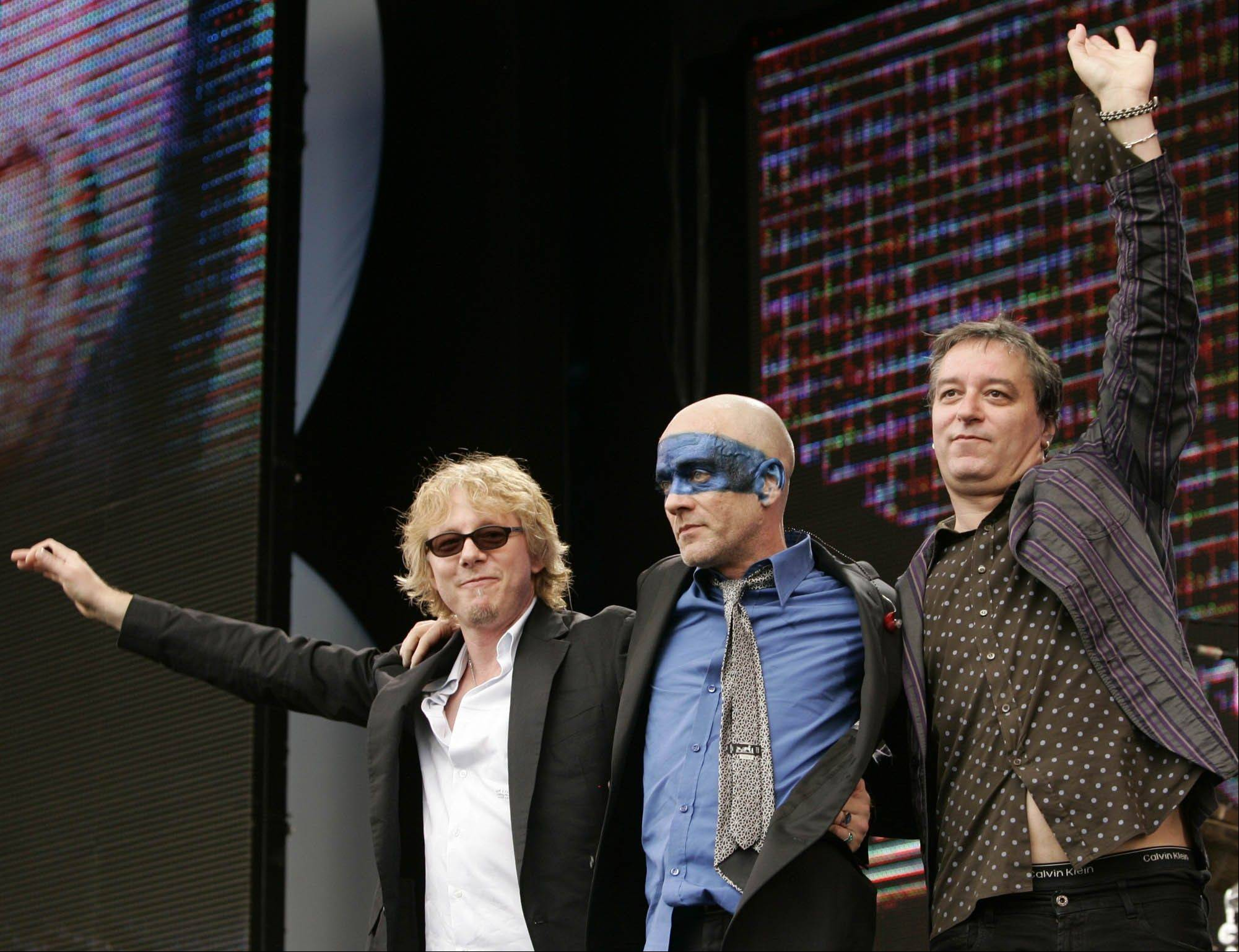 Mike Mills, left, Michael Stipe and Peter Buck of the rock band R.E.M have announced on their website that they are breaking up.