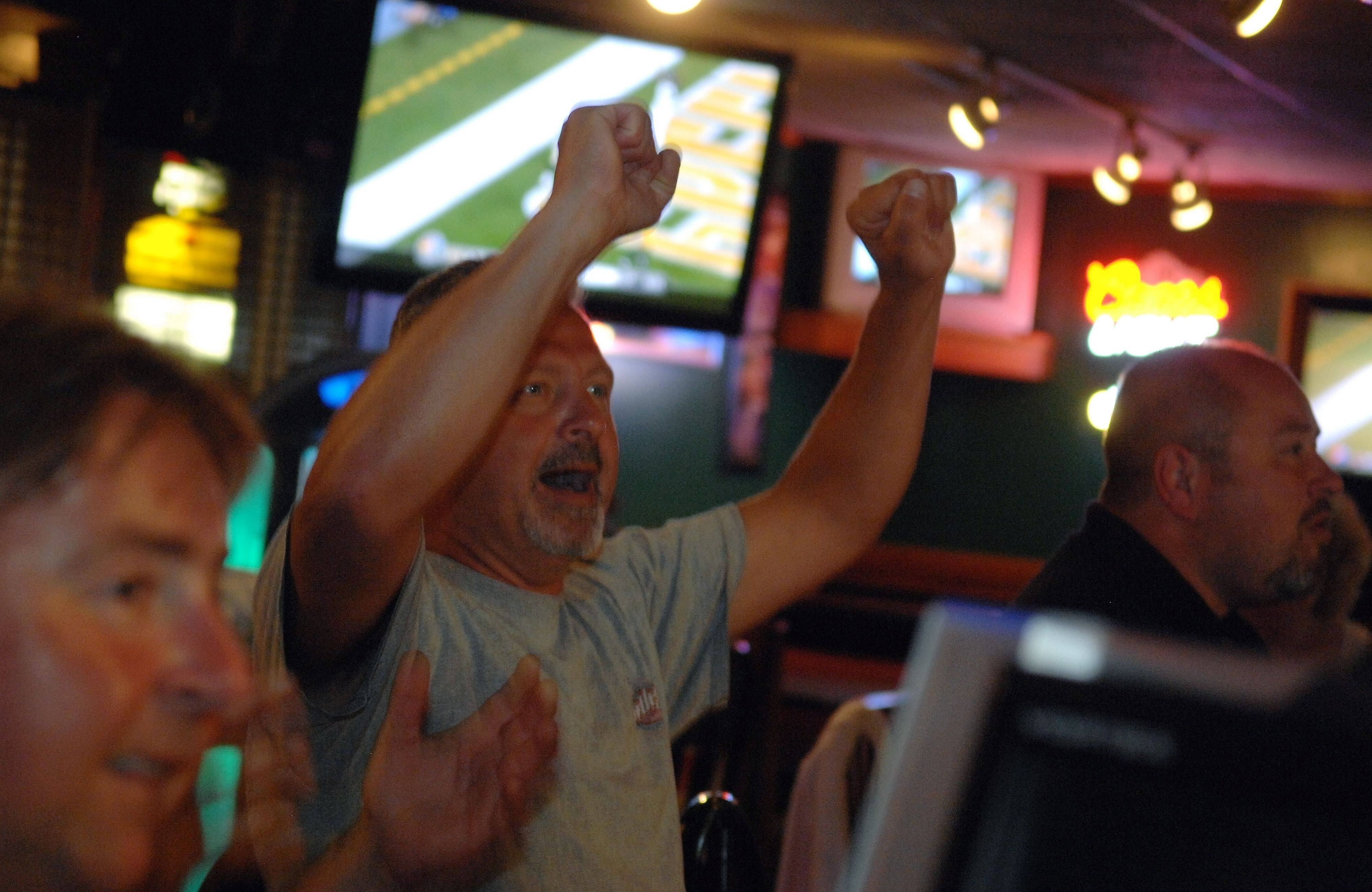 Chris Caviello of Elgin watches football at Hoopers Sports Bar & Grill.
