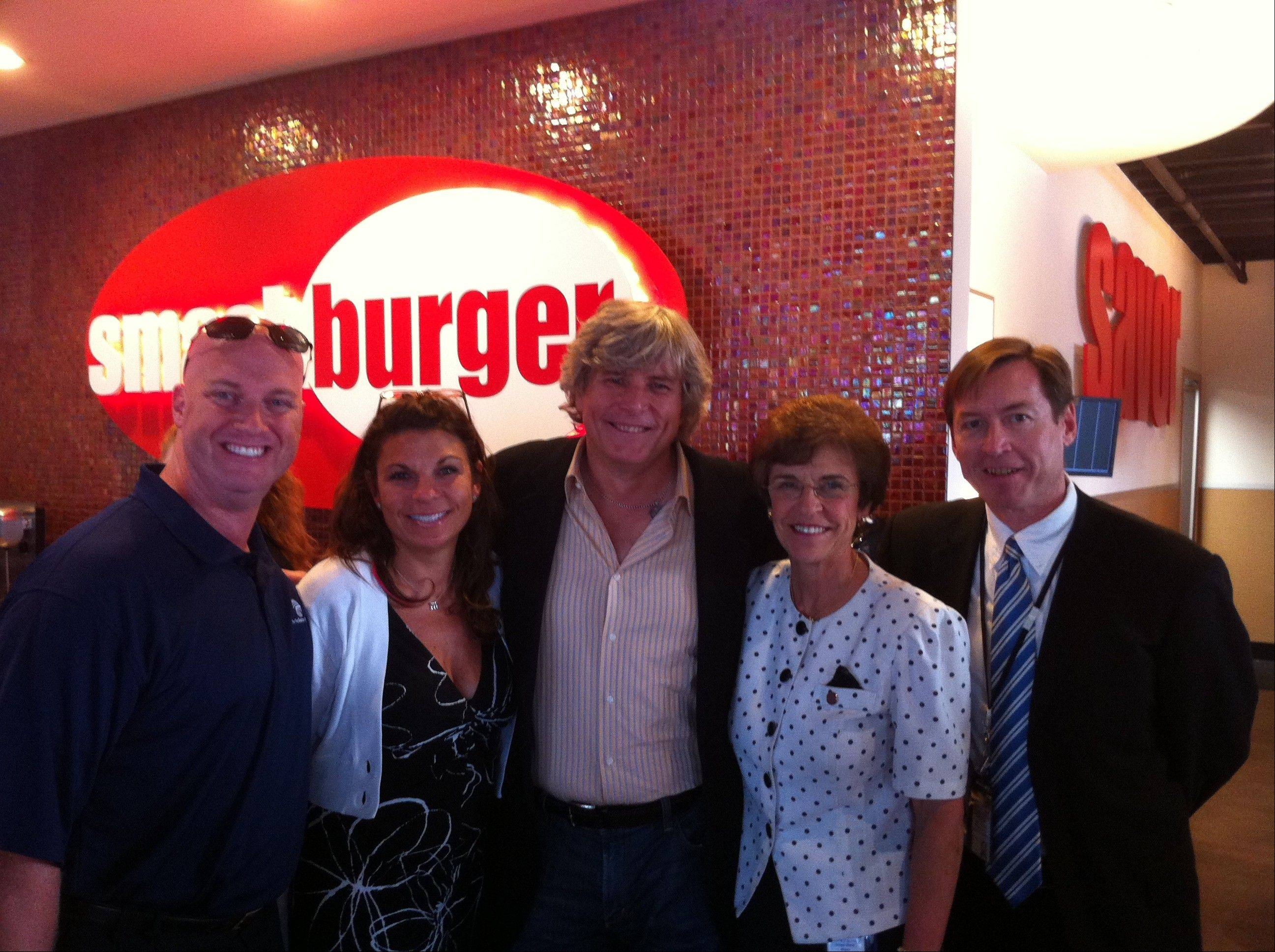 Arlington Heights Chamber of Commerce member Jay Beaton, from left, chamber business development director Mary Beisemann, Smashburger founder Tom Ryan, Arlington Heights Mayor Arlene Mulder, and city planner John Melaniphy were all smiles on opening night of the new Smashburger in town.