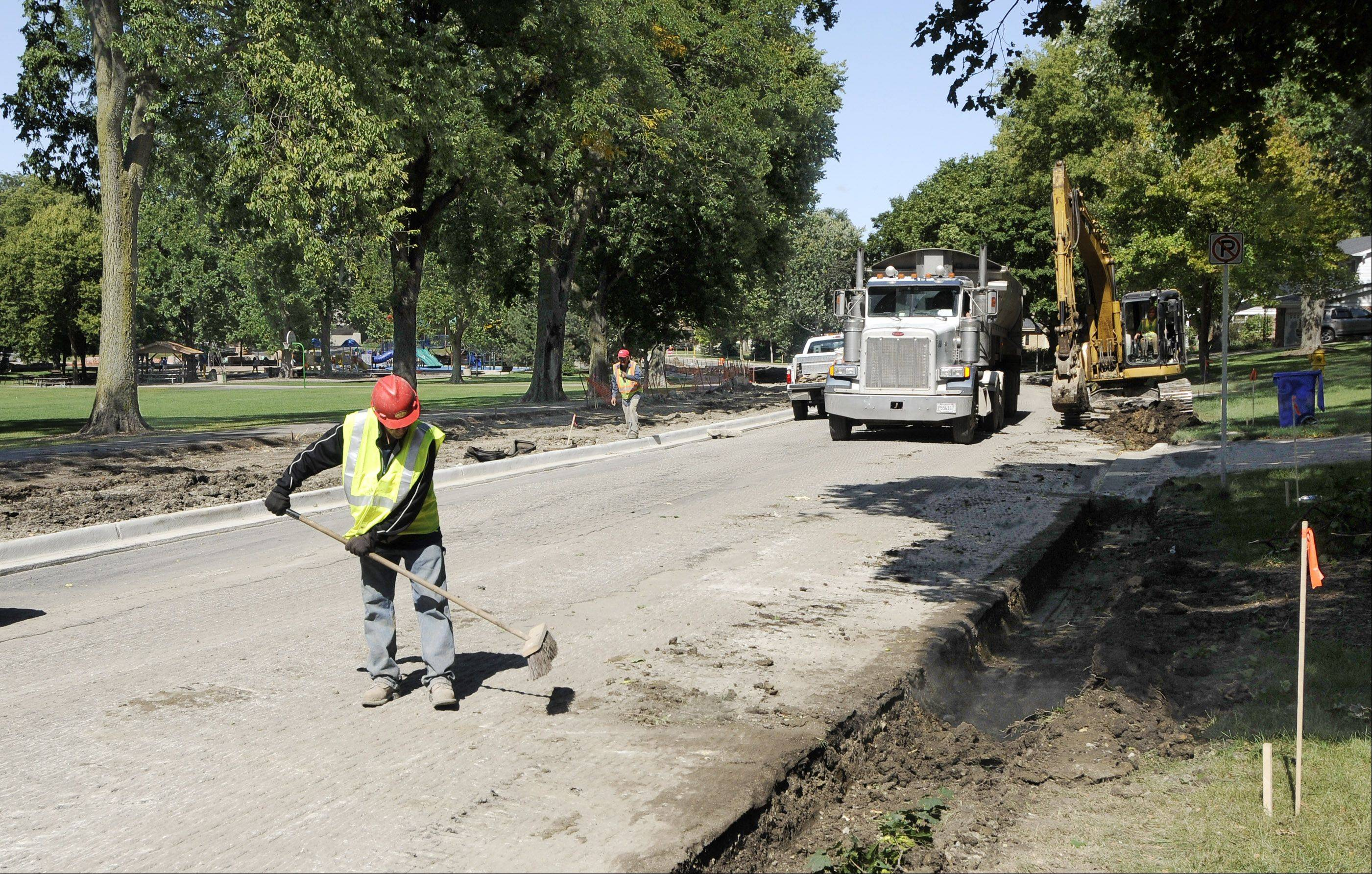 New pavement is being installed on South Main Street by Kelly Park in Wheaton.