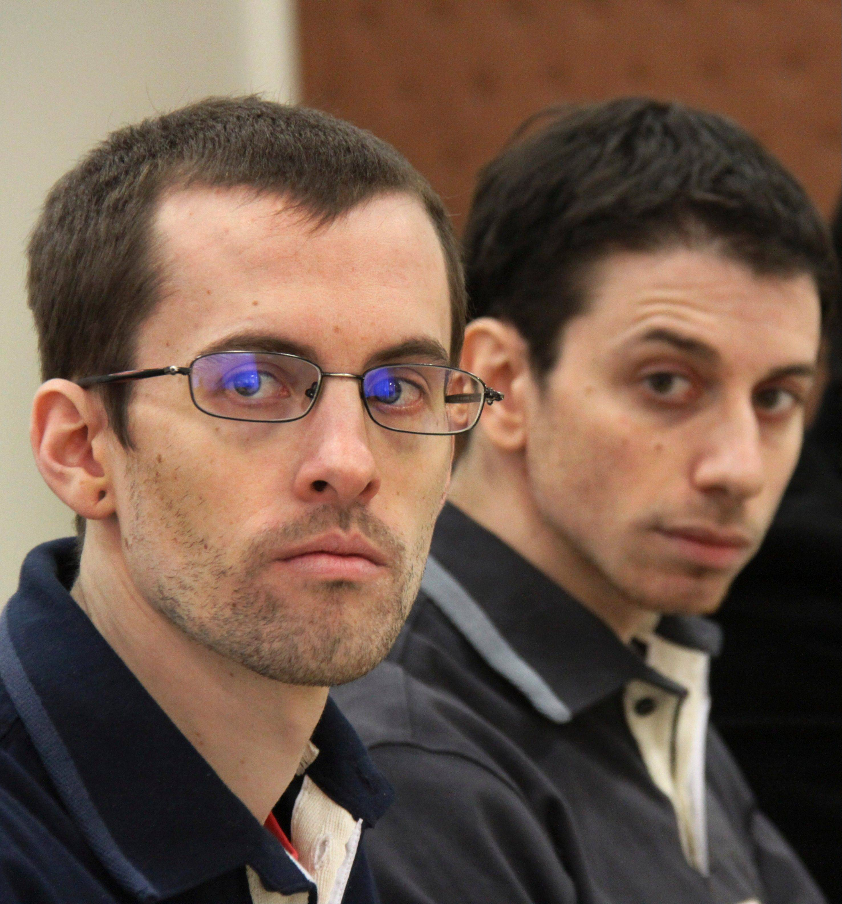 U.S. hikers Shane Bauer, left, and Josh Fattal, seen above at a hearing last February, were released from Iranian custody Wednesday.