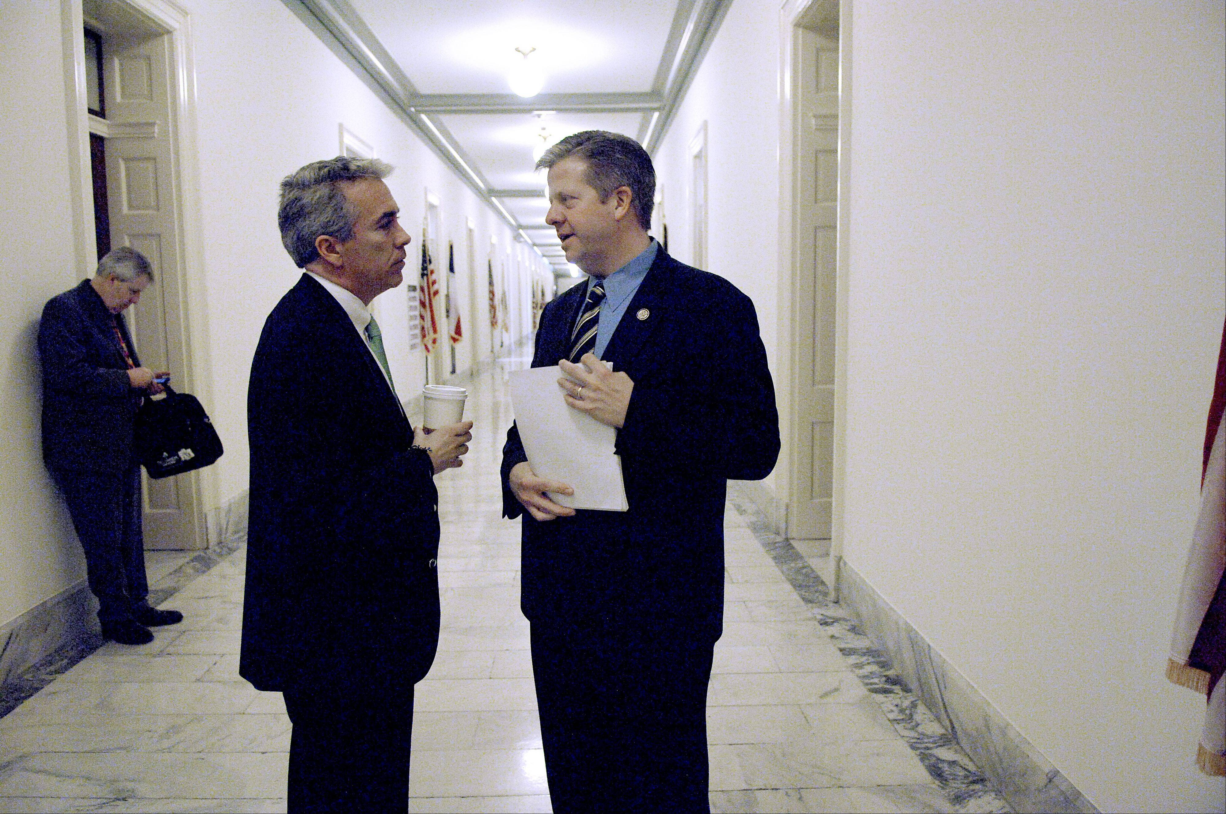 Illinois congressmen Joe Walsh, left, and Randy Hultgren chat in the hallway of the Cannon House office building in Washington D.C. shortly after both took office. Now, the two are facing each other in a primary election battle.