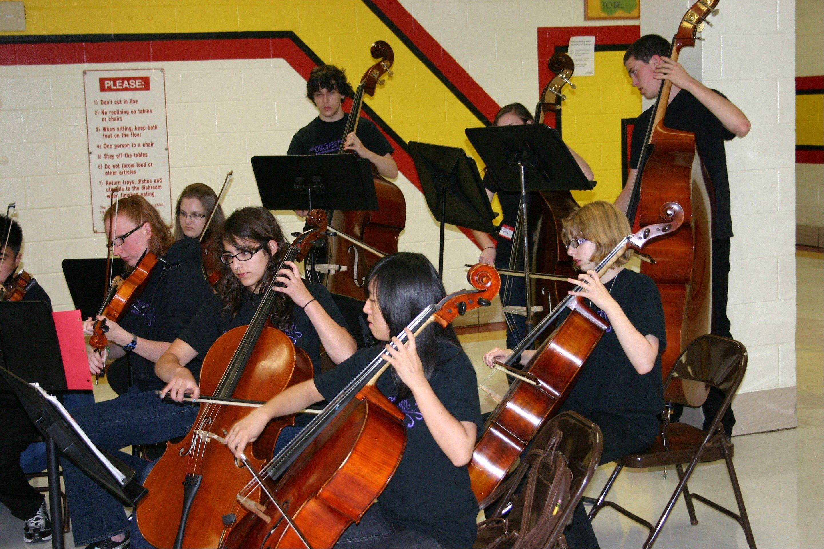 Open House at Schaumburg High School featured performances by the school's orchestra in the cafeteria throughout the evening.