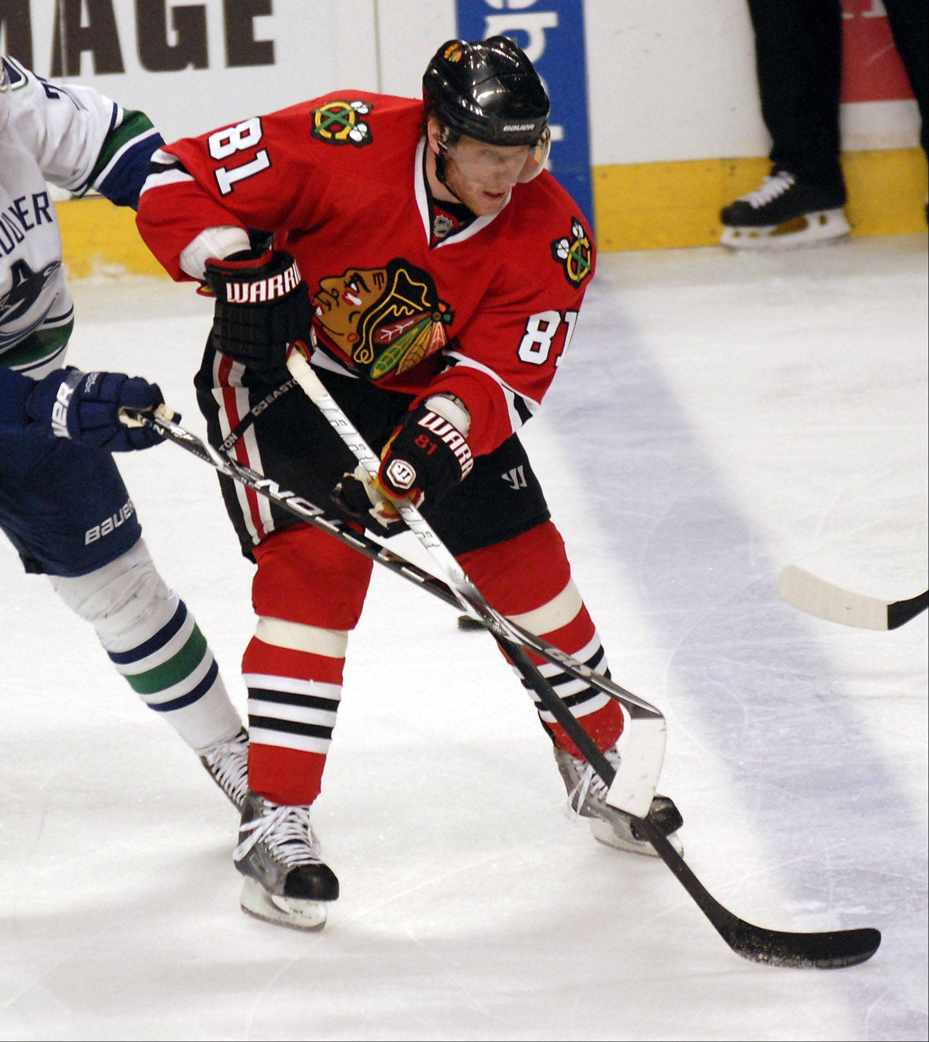 Marian Hossa rejoined the Blackhawks on Wednesday after mourning the loss of his best friend and welcoming a daughter.