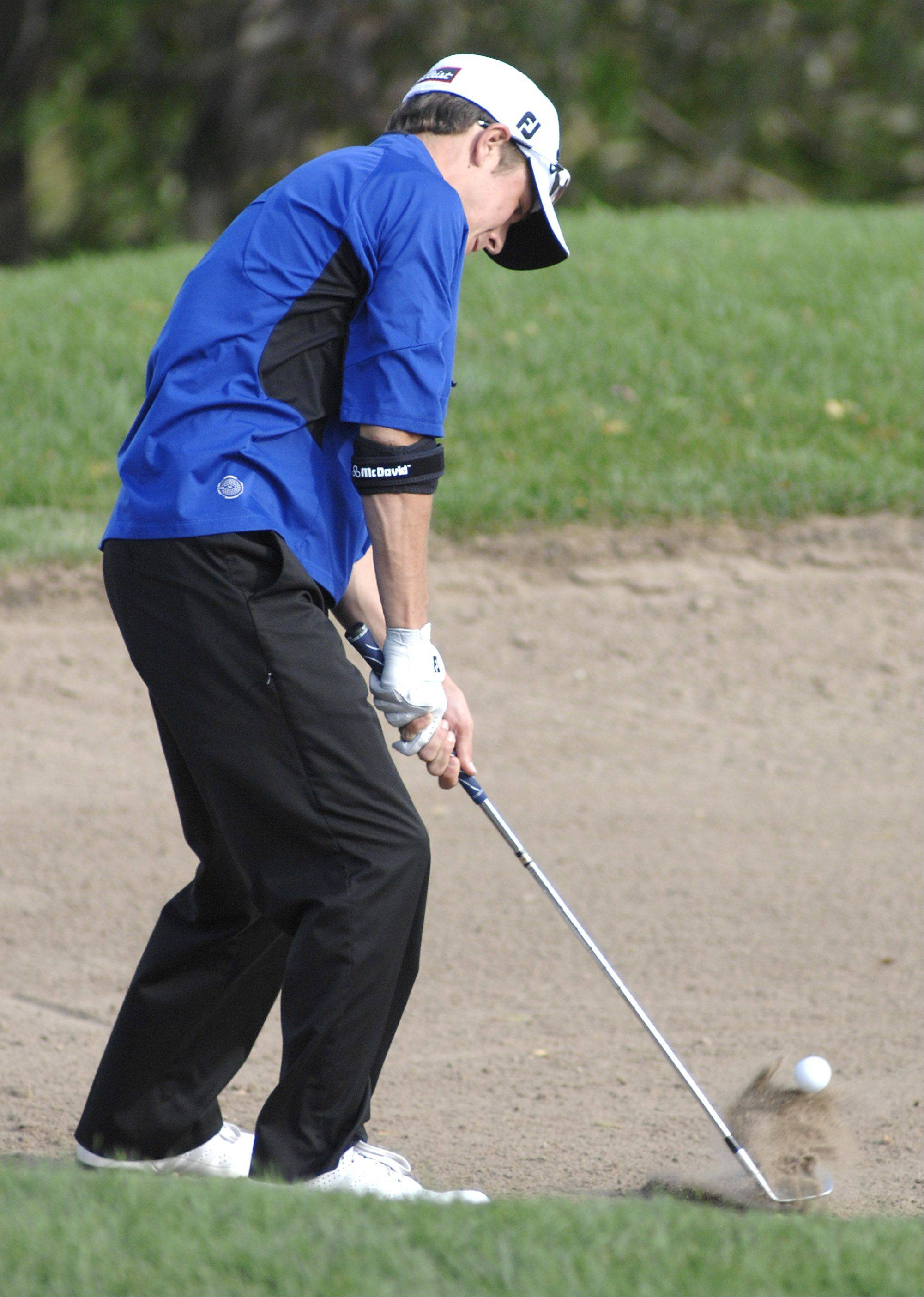 Geneva�s Colin Lillibridge hits out of a sand bunker on the 11th hole on Wednesday, September 21.