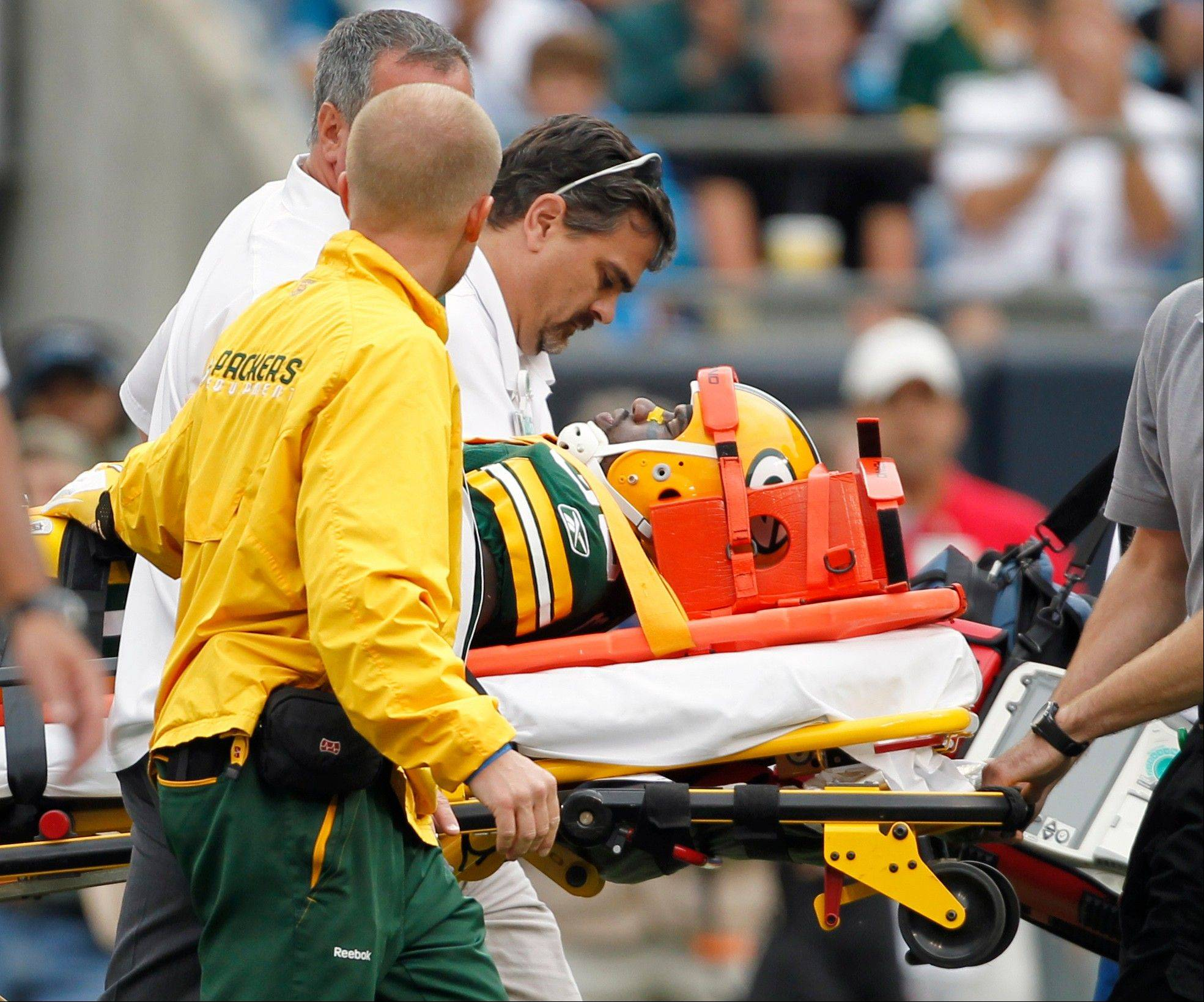 The Green Bay Packers� Nick Collins is carted off the field after being injured during the fourth quarter of the Packers� 30-23 win over the Carolina Panthers Sunday.