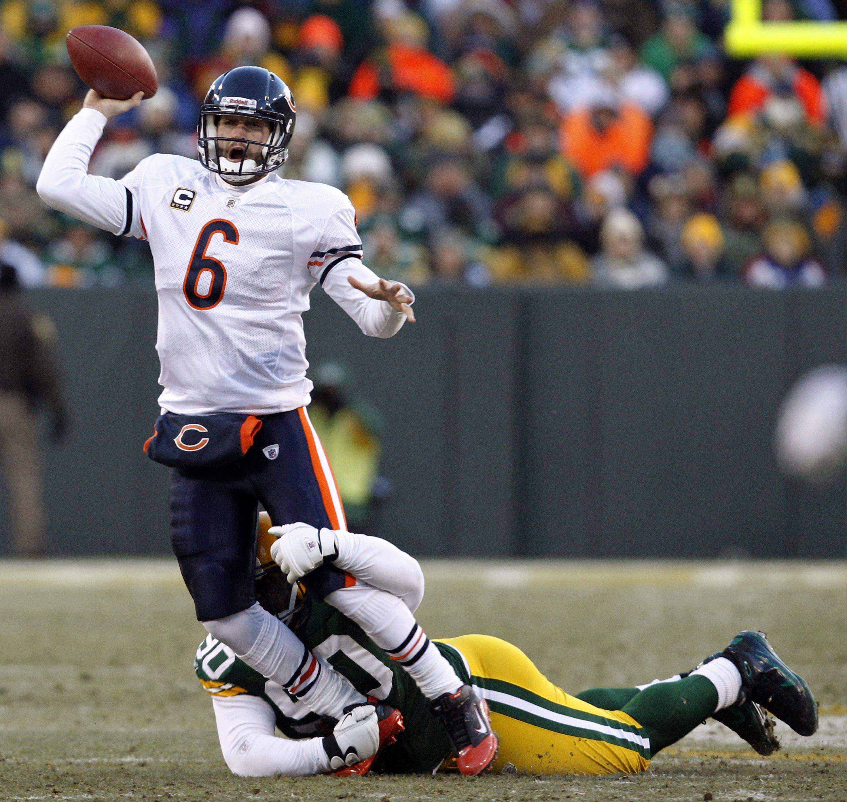 Still sore from the beating he took against the New Orleans Saints, Bears quarterback Jay Cutler said he expects to recover in time for Sunday�s game against the Green Bay Packers at Soldier Field. In this photo, B.J. Raji of the Packers wraps up Cutler in the NFC Championship game last January.