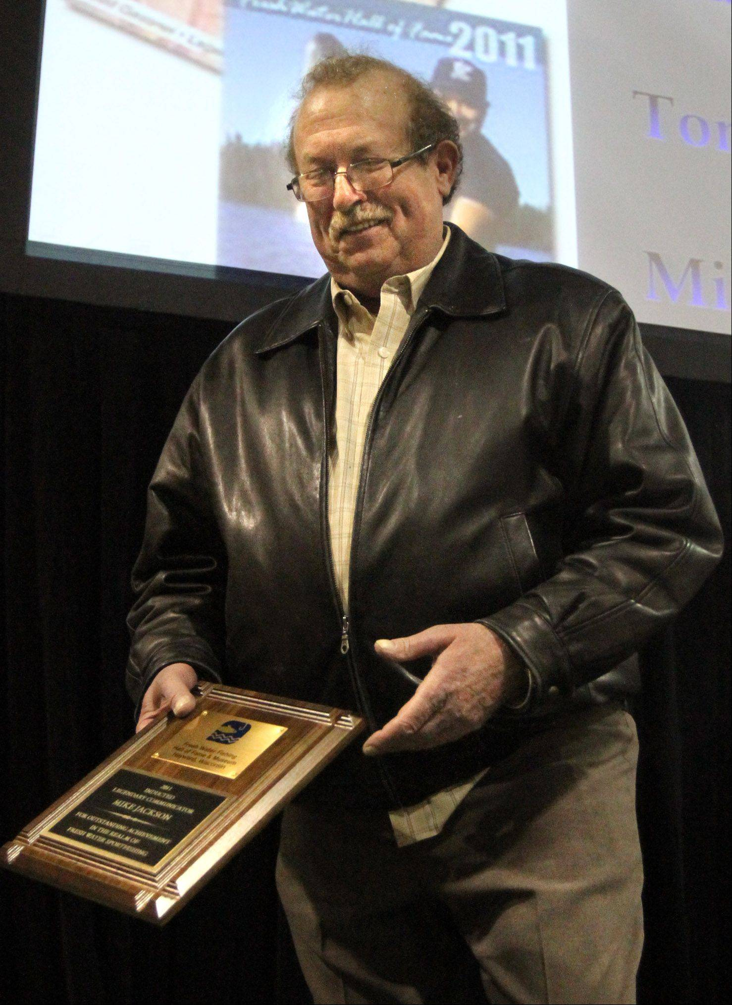 Daily Herald outdoors columnist Mike Jackson, who was inducted into Freshwater Fishing Hall of Fame at the America's Outdoor Show in Rosemont last January, will be sitting out the fall hunting and fishing season as he recovers from lung cancer surgery.