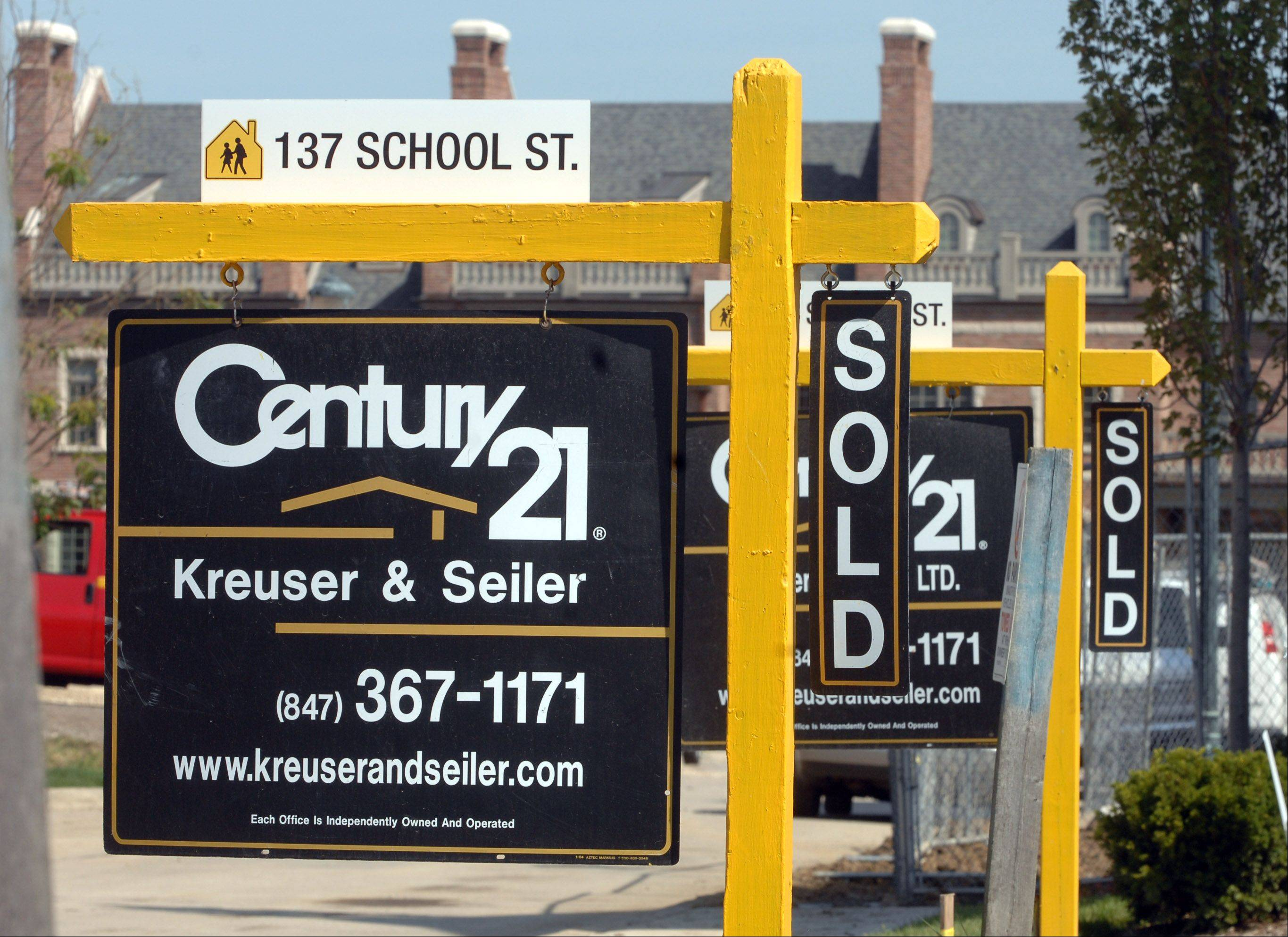 """Sold"" signs, like these at the School Street development in downtown Libertyville, are increasing in Lake County, which had 726 homes sold during August compared to 513 the year before, according to a report Wednesday by the Illinois Association of Realtors."