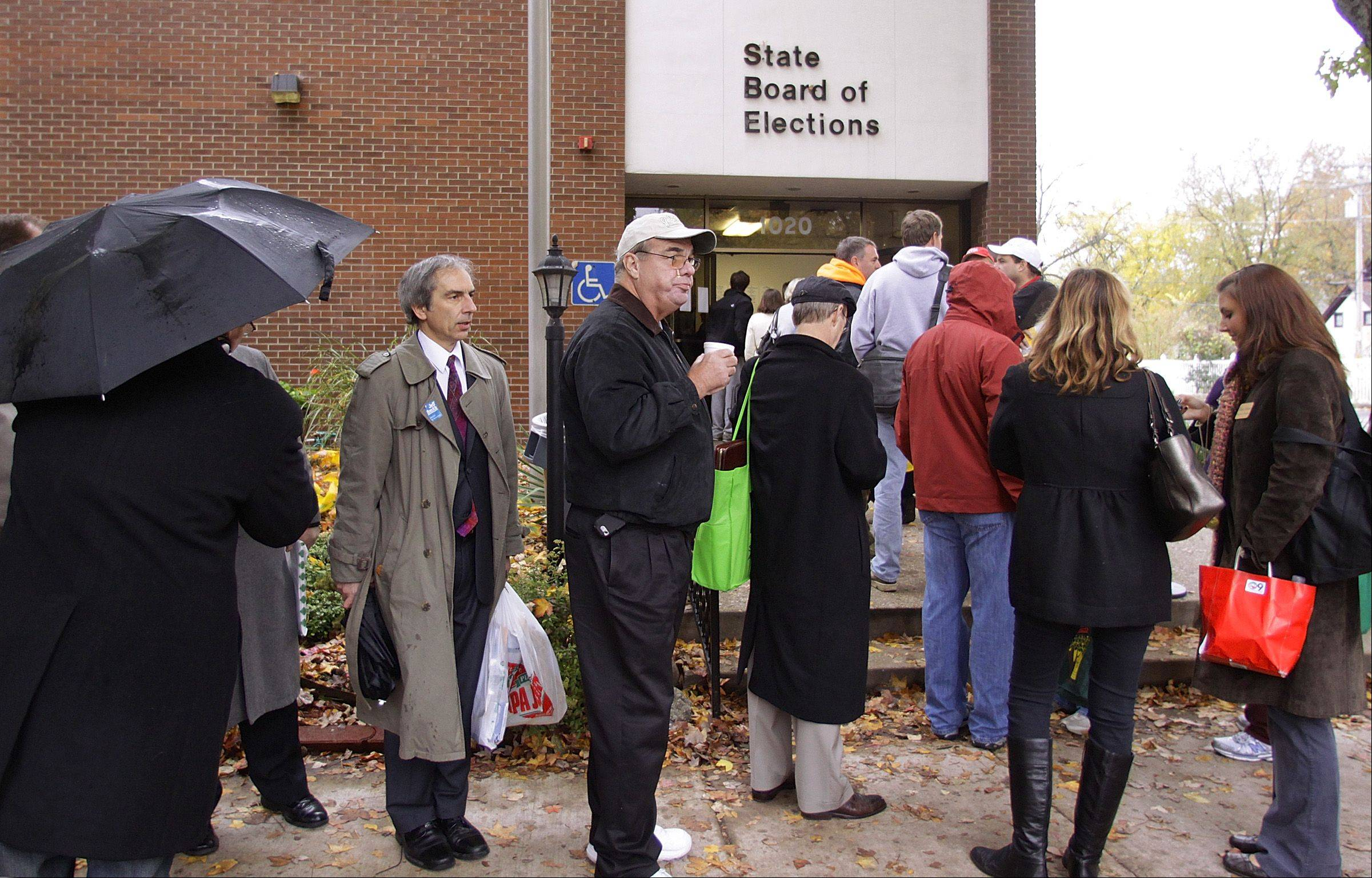 Candidates stand in line outside the Illinois State Board of Elections in Springfield to get on the ballot. If they don't file financial statements on time, they can face fines but often get them reduced or eliminated by the board.