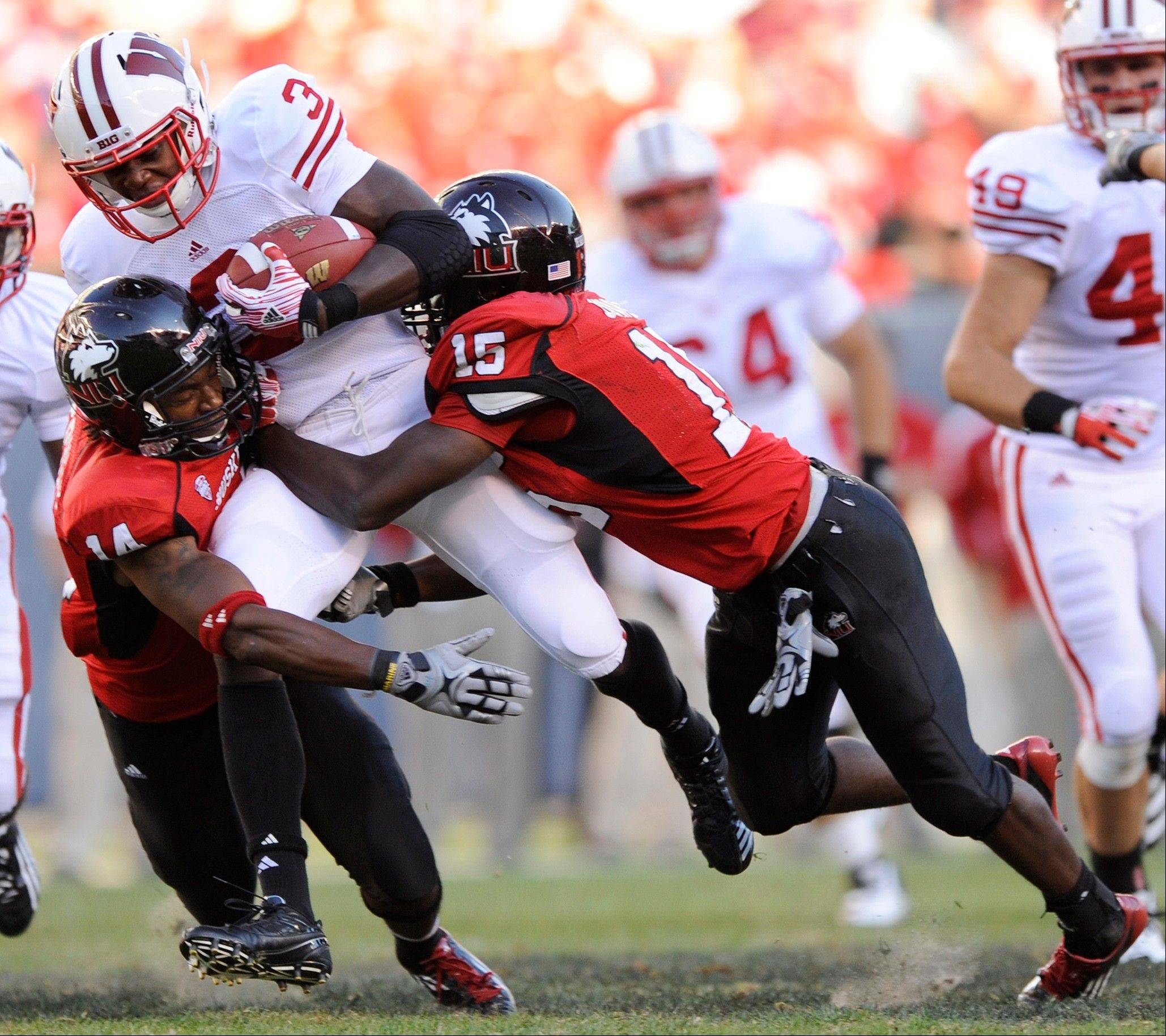 Wisconsin's Melvin Gordon (3) is tackled by Northern Illinois' Courtney Stephen, left, and Jimmie Ward during the fourth quarter of the Badgers' 49-7 victory last week. NIU ranks dead last in the MAC in rushing defense and pass efficiency defense.