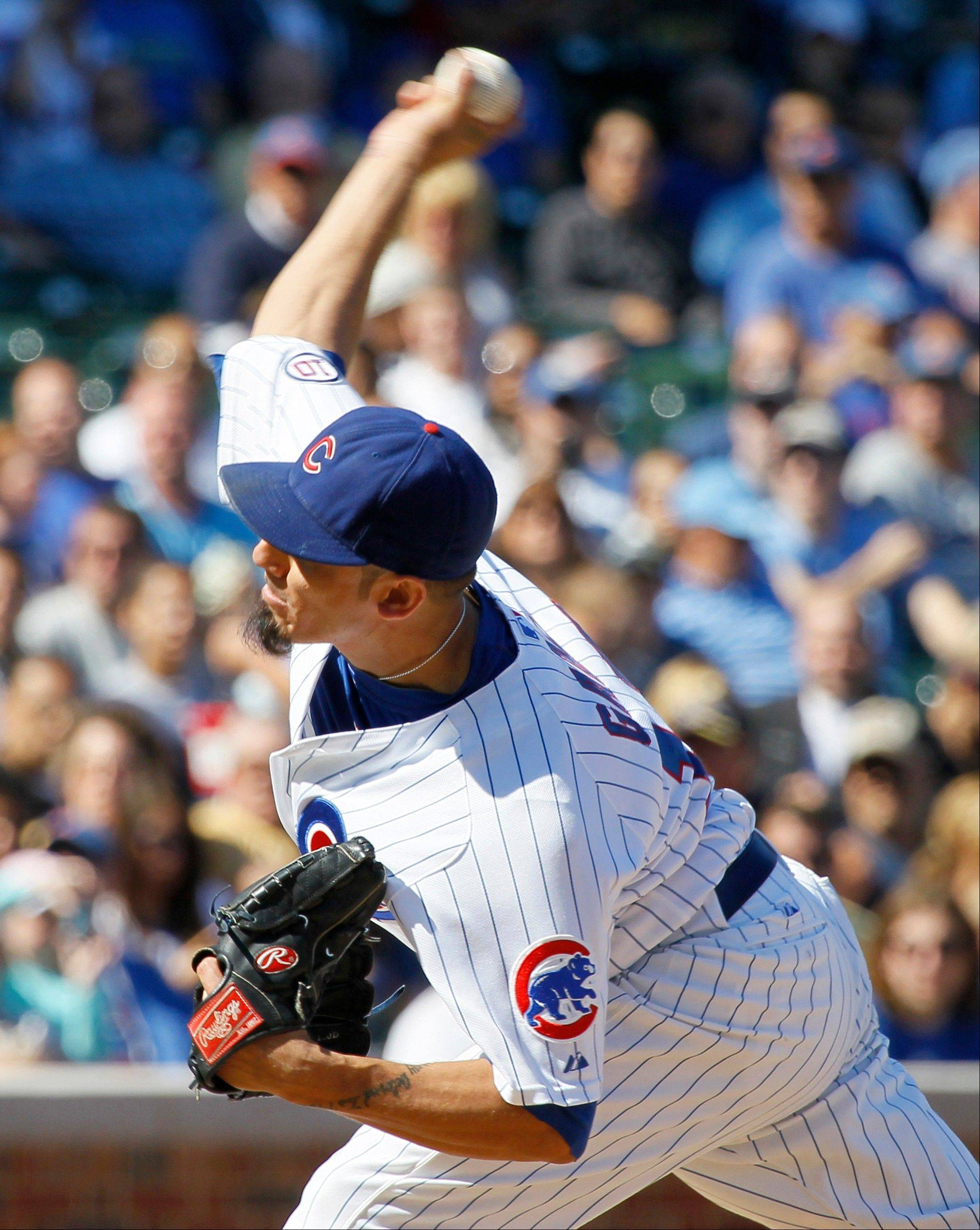 Cubs starting pitcher Matt Garza delivers during the second inning of a baseball game against the Milwaukee Brewers, Wednesday, Sept. 21, 2011, in Chicago.