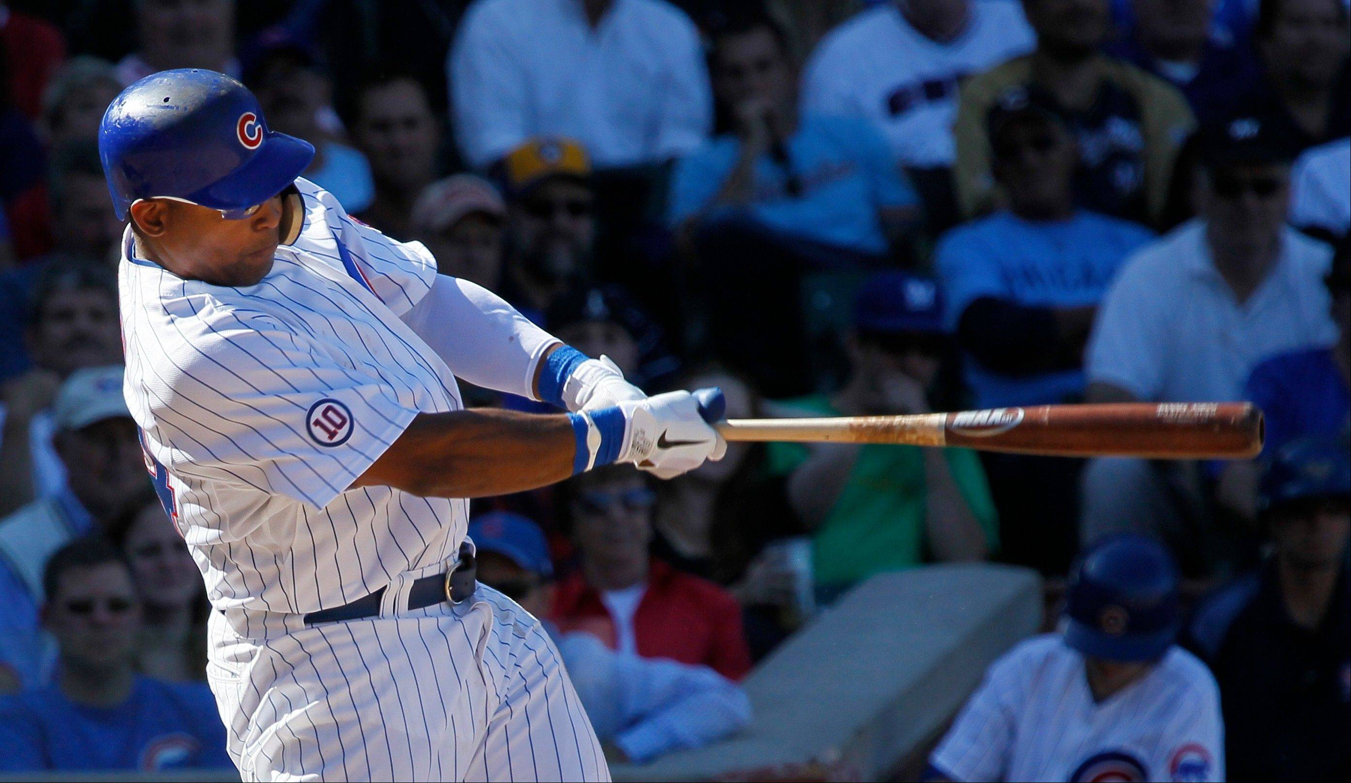 The Cubs' Marlon Byrd hits a 3-run home run during the sixth inning Wednesday.