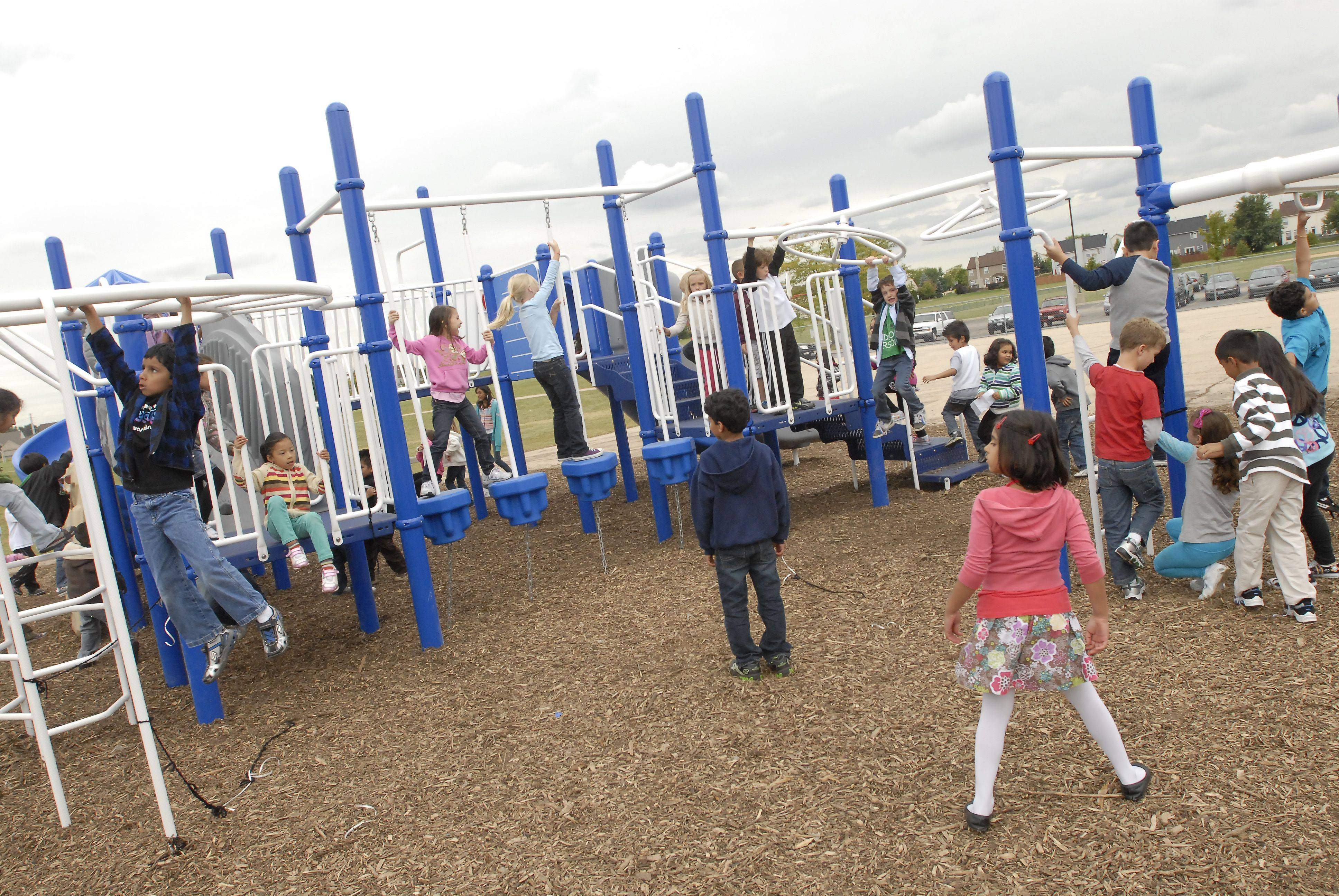 Students check out the new playground equipment at Nature Ridge Elementary School in Bartlett.