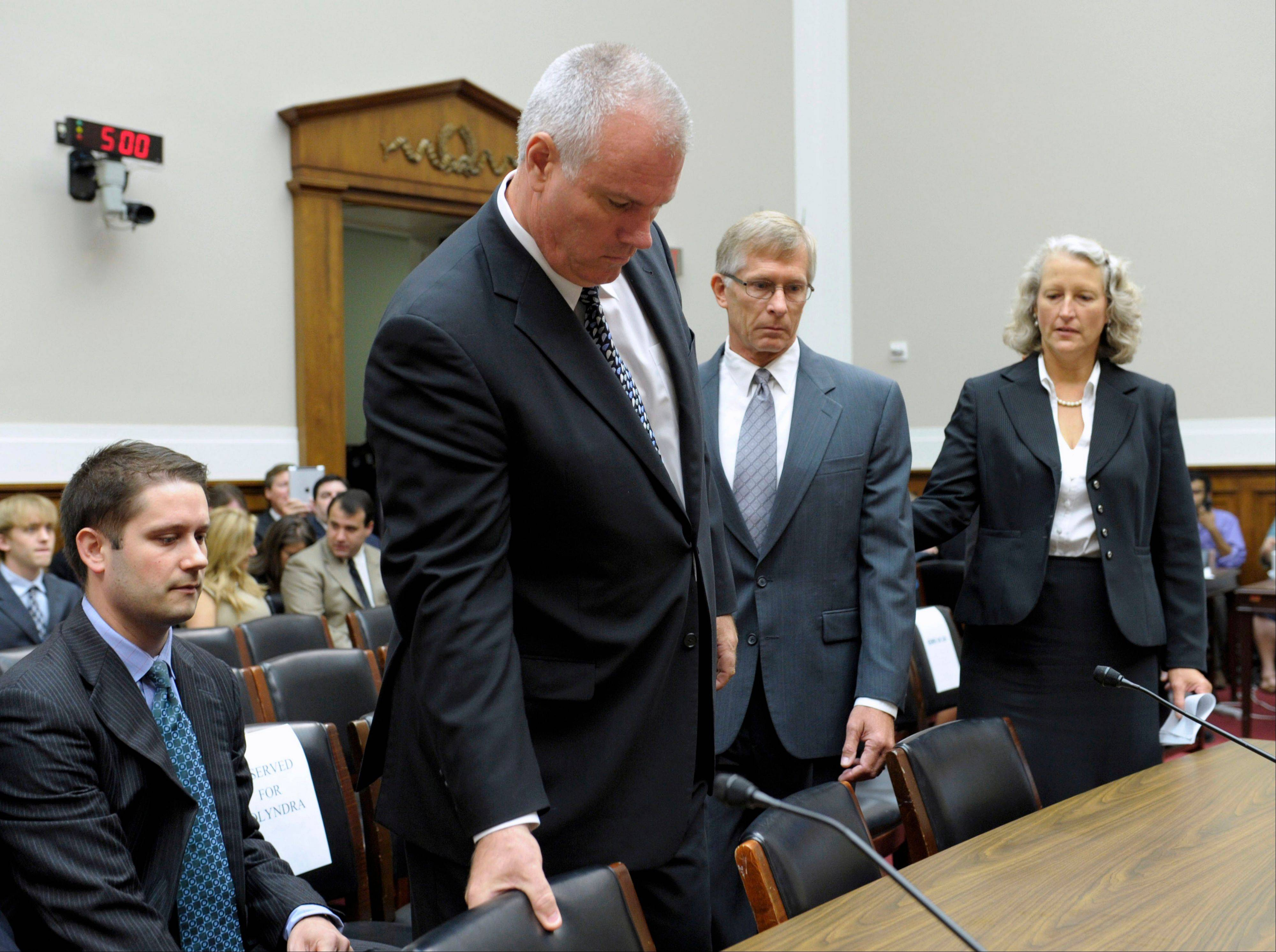 Solyndra CEO Brian Harrison, second from left, and Chief Financial Officer Bill Stover, second from right, arrive Friday on Capitol Hill in Washington.
