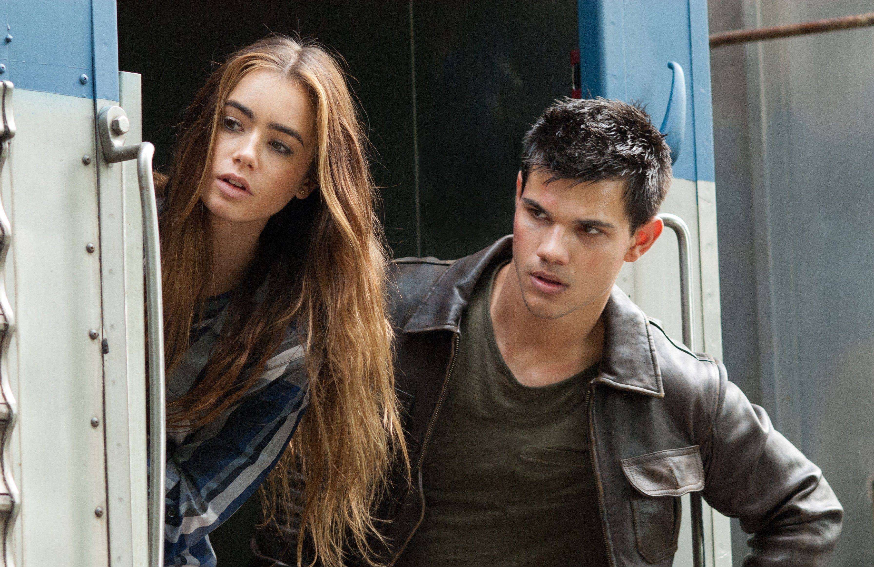 "Taylor Lautner, right, and Lily Collins are on the run in ""Abduction."""