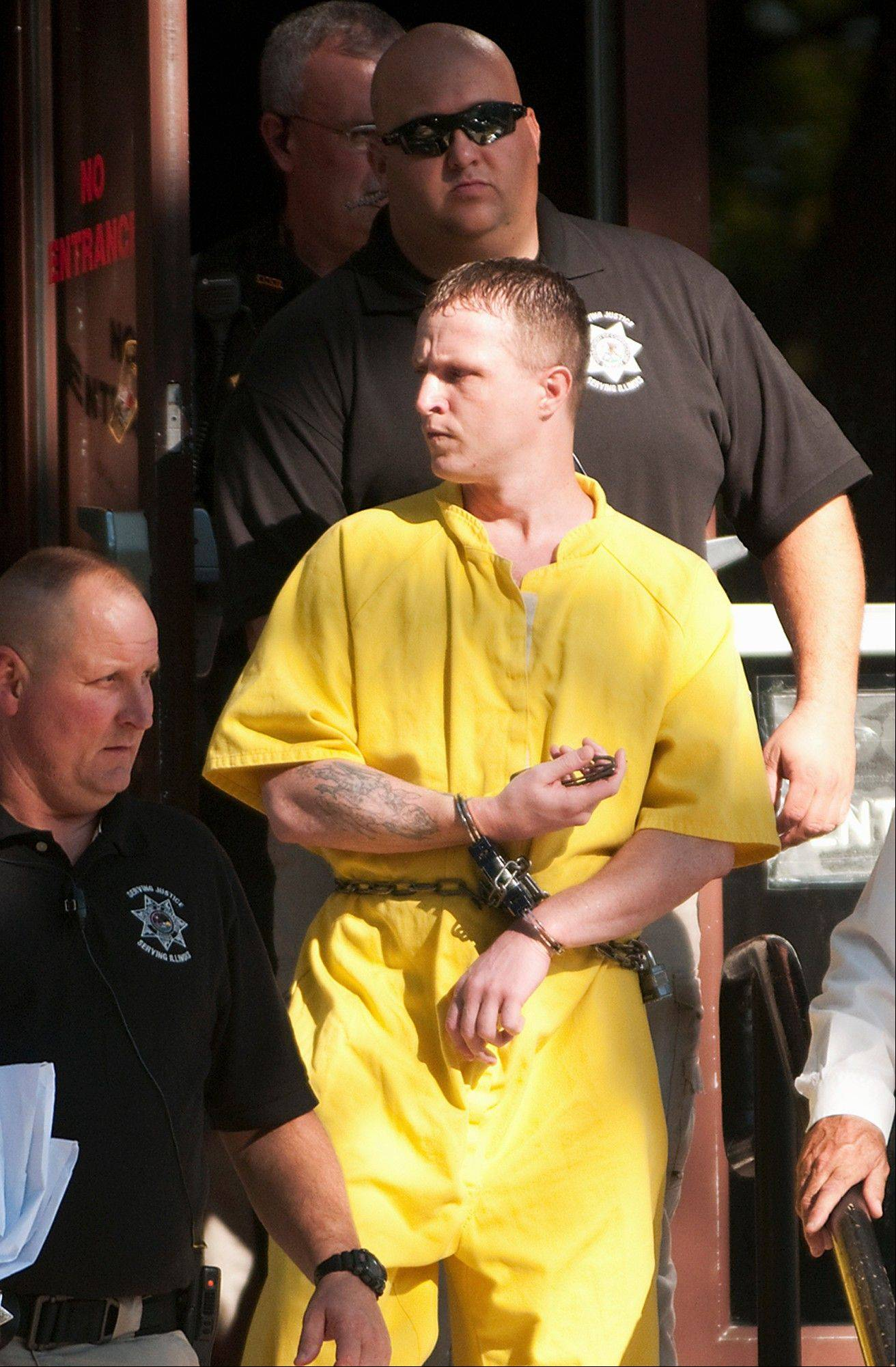 Nicholas Sheley is led out of the Knox County courthouse on Monday in Galesburg, Ill., after being found guilty of first-degree murder in the June 2008 death of 65-year-old Ronald Randall, the first of eight killings he�s accused of in Illinois and Missouri.