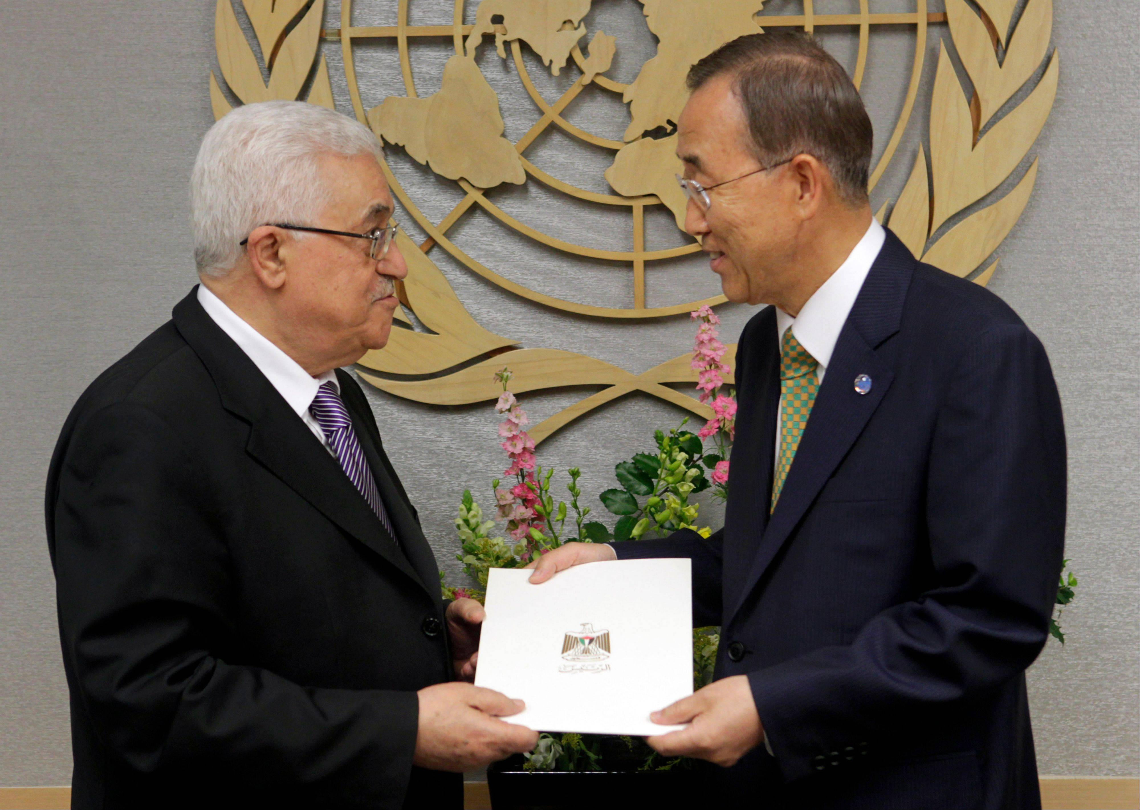 Palestinian President Mahmoud Abbas, left, gives a letter requesting recognition of Palestine as a state to Secretary-General Ban Ki-moon during the 66th session of the General Assembly at United Nations headquarters Friday, Sept. 23, 2011.