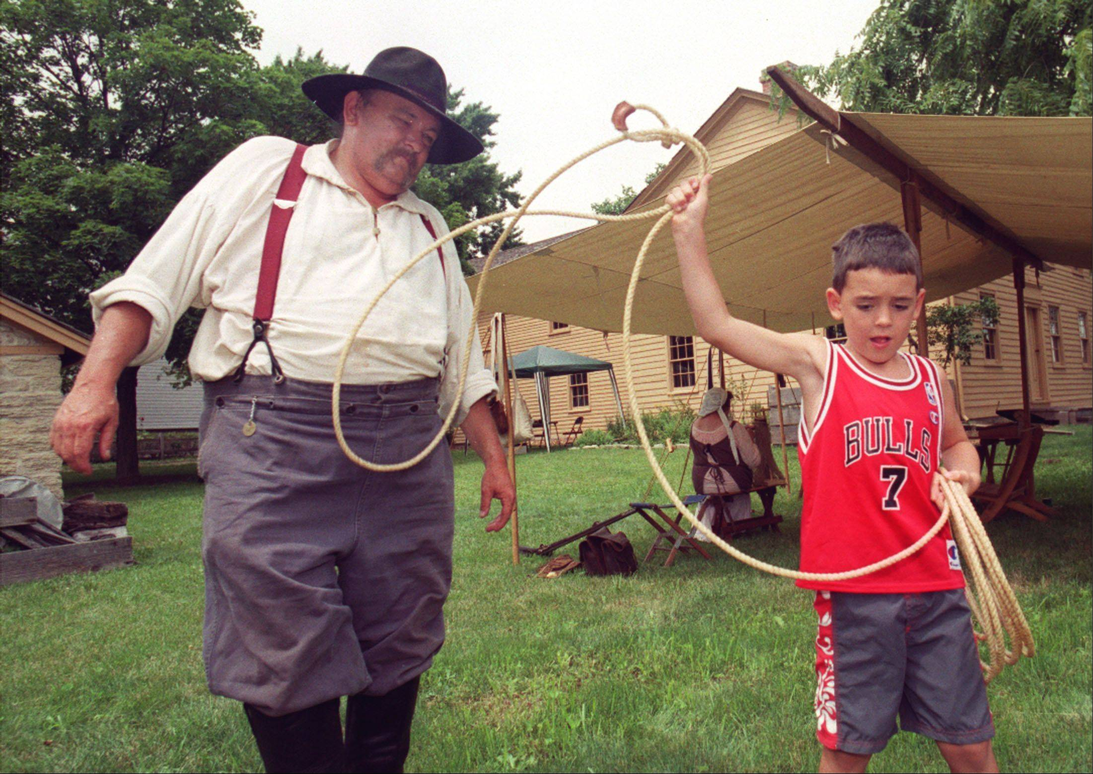 Attendees of the Glen Ellyn Historical Society's annual Tavern Day can play with 1840s-era games.
