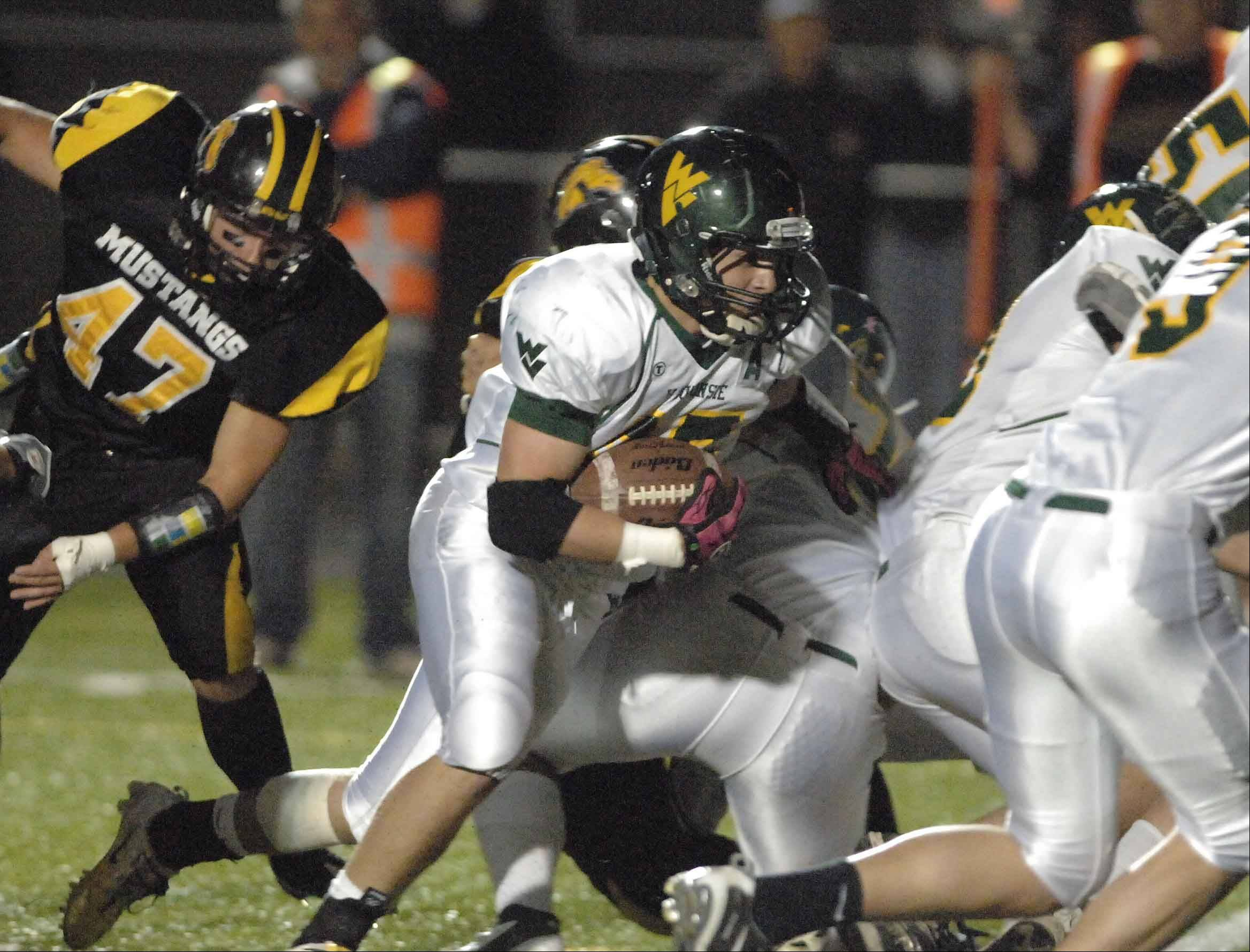 Austin Guido of Waubonsie on the run during the Waubonsie Valley at Metea Valley football game Friday.