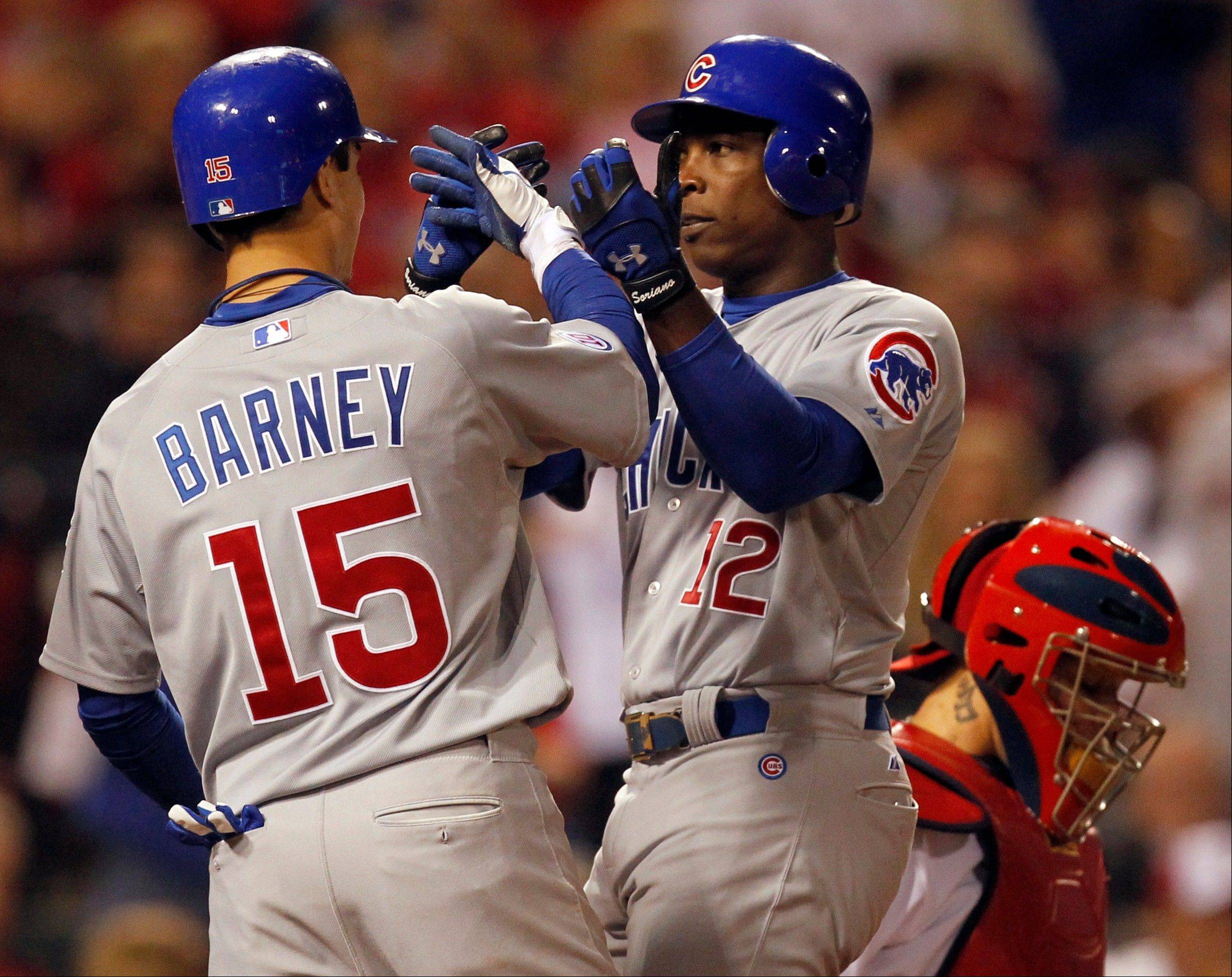 Alfonso Soriano, center, is congratulated by Darwin Barney after hitting a 3-run home run to give the Cubs a 4-1 lead in the eighth inning of their victory at St. Louis on Friday.