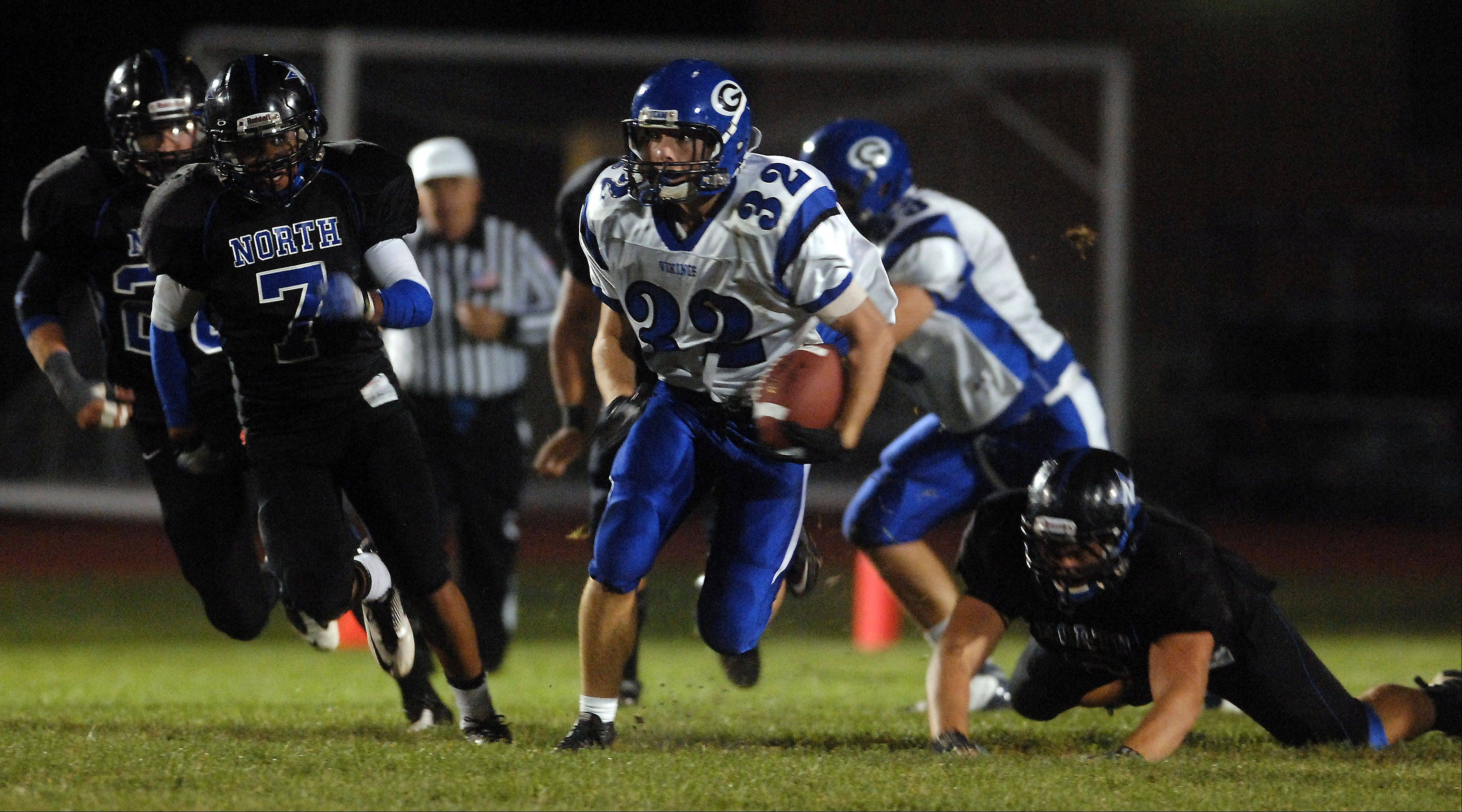 Geneva�s Bobby Hess finds a seam up the middle against St. Charles North during Friday�s game at St. Charles North.