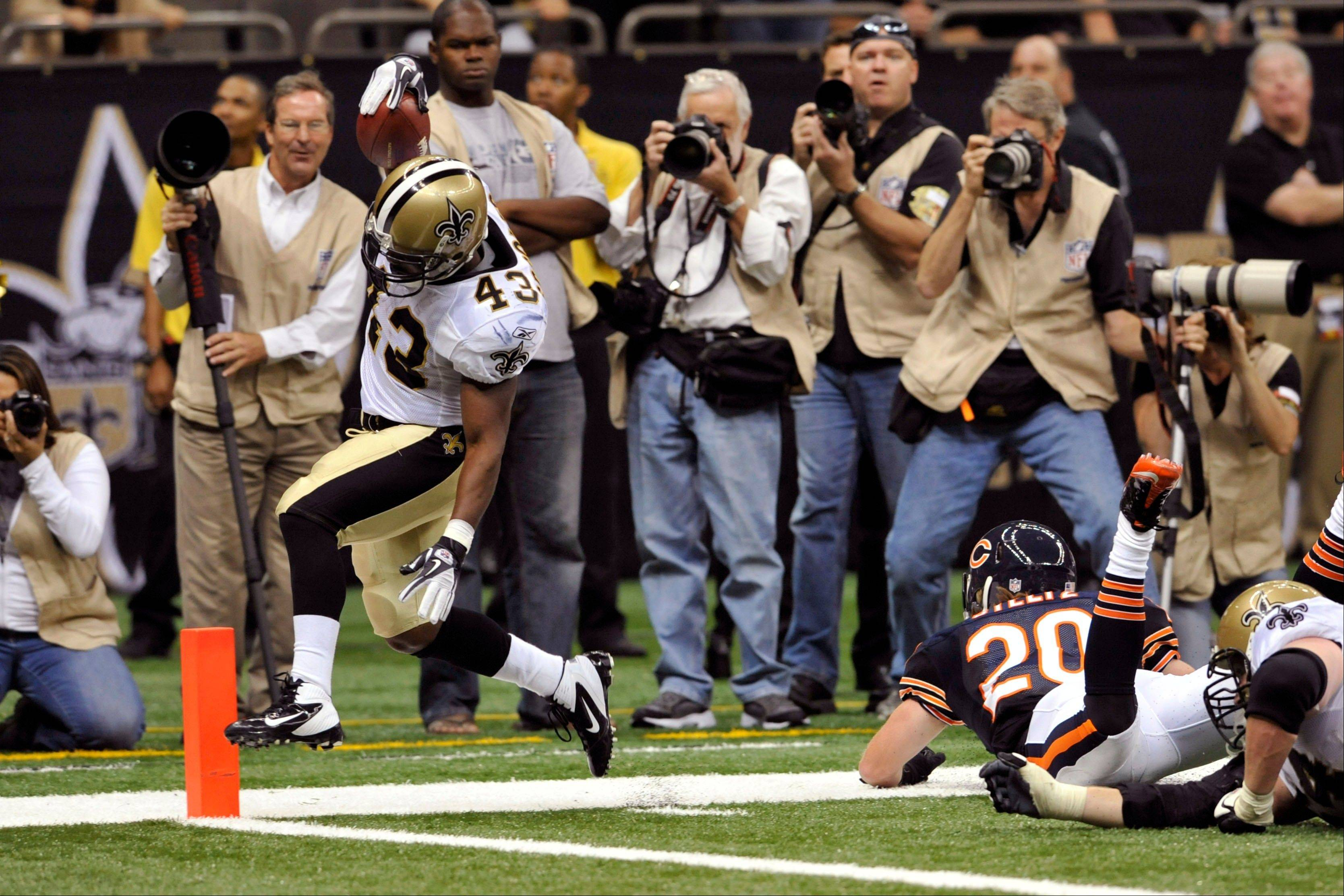 New Orleans Saints running back Darren Sproles (43) scores a touchdown past Chicago Bears defensive back Craig Steltz (20) during the fourth quarter an NFL football game at the Louisiana Superdome in New Orleans, Sunday, Sept. 18, 2011. (AP Photo/Bill Feig)