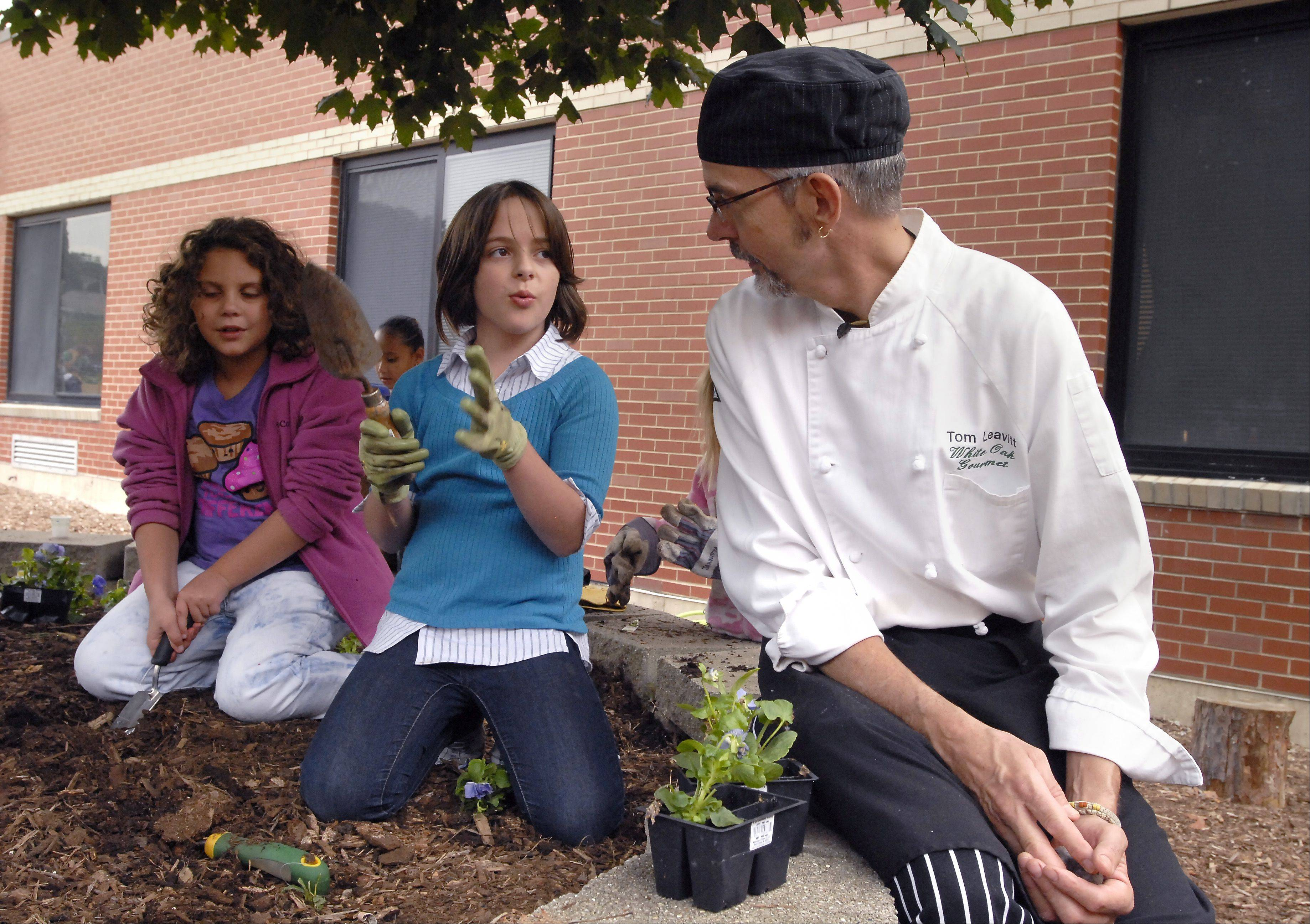 Third-graders Gaby Whisler, left, and Mary Lazzaretti talk with Chef Thomas Leavitt.