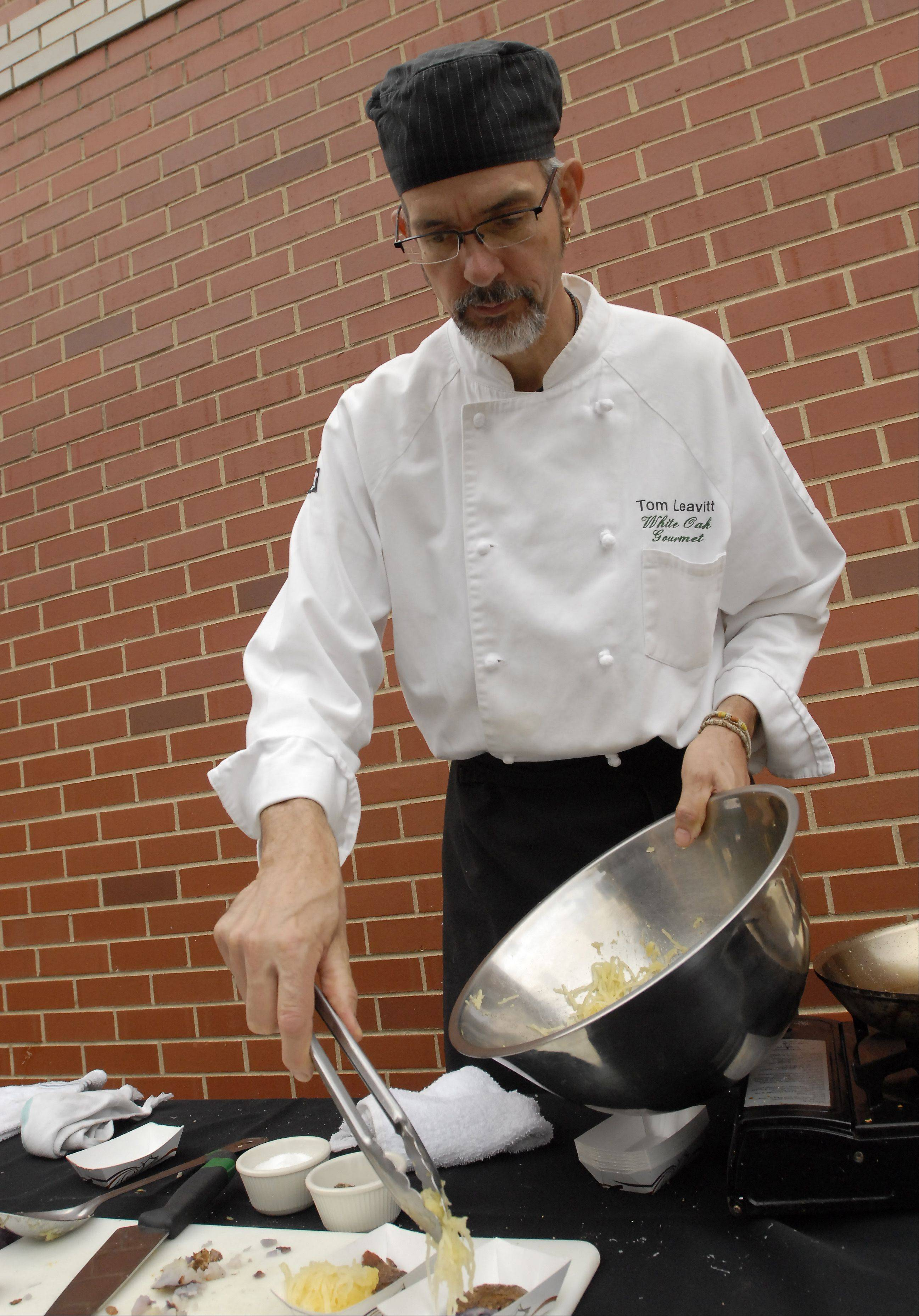 Chef Thomas Leavitt, owner of White Oak Gourmet personal chef service, prepares spaghetti squash with marinara sauce and smashed purple potatoes.