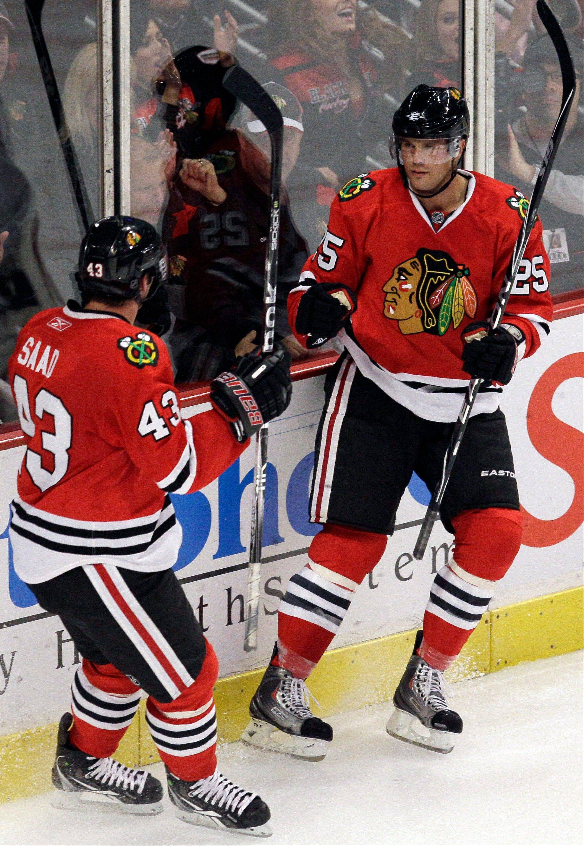 Chicago Blackhawks' Viktor Stalberg (25) celebrates with Brandon Saad (43) after scoring a goal during the third period of an NHL preseason hockey game against the Washington Capitals in Chicago, Friday, Sept. 23, 2011. The Blackhawks won 3-2.