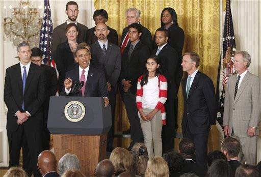 President Barack Obama stands with educators and students as he speaks about No Child Left Behind Reform, Friday, Sept. 23, 2011, in the East Room of the White House in Washington. Also pictured are Education Secretary Arne Duncan is at left, Tennessee Gov. Bill Haslam, is second right, and Rhode Island Gov. Lincoln Chafee is at right.