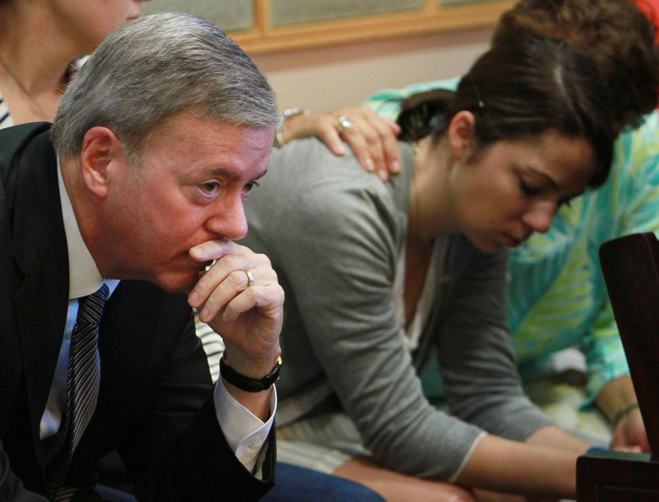 Robert Ward and his daughter Mallory wait Saturday as the jury in his murder trial returns to court.