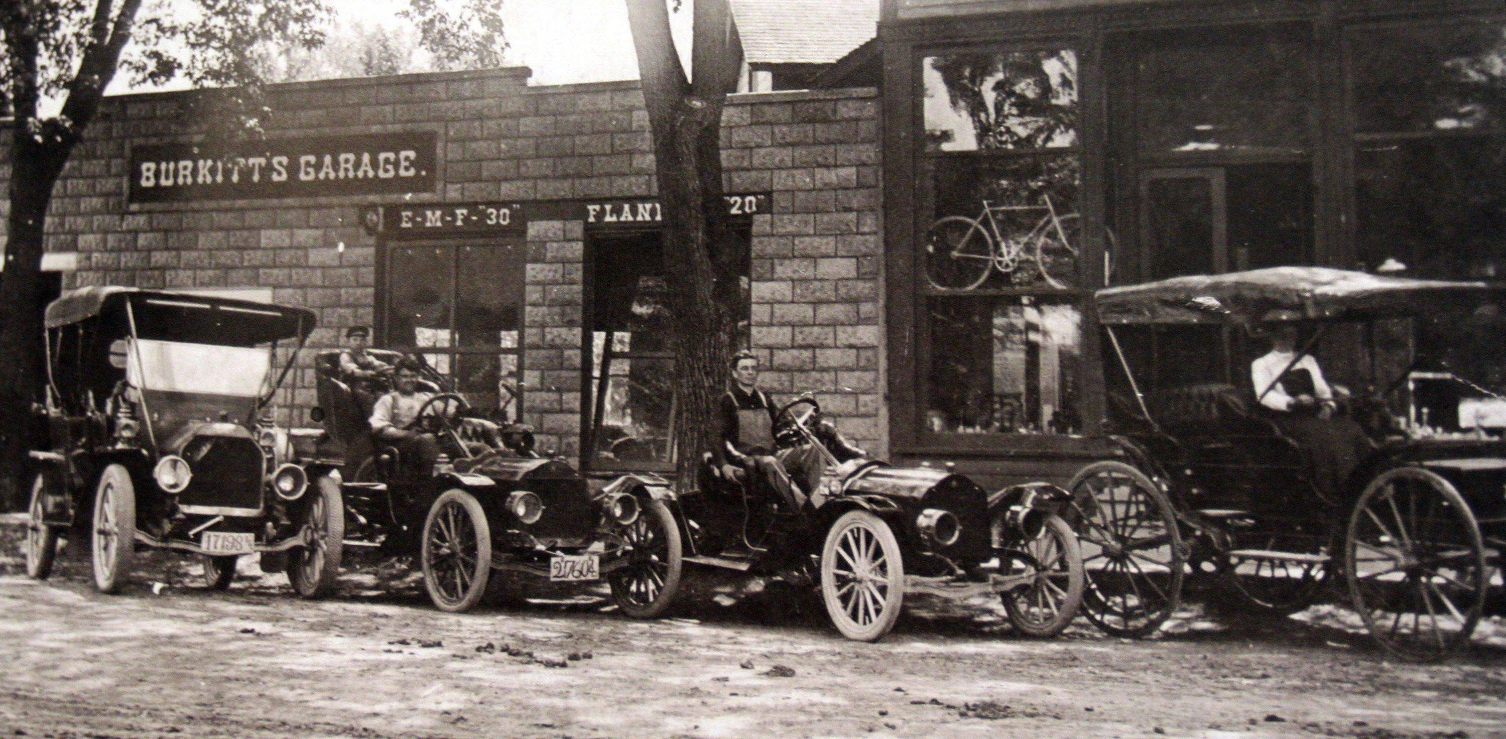 Root around the attic for photos like this one, of Burkitt's Garage in the early 1910s. In 1910, John Burkitt Sr. opened the first auto dealership in the village on Davis Street.