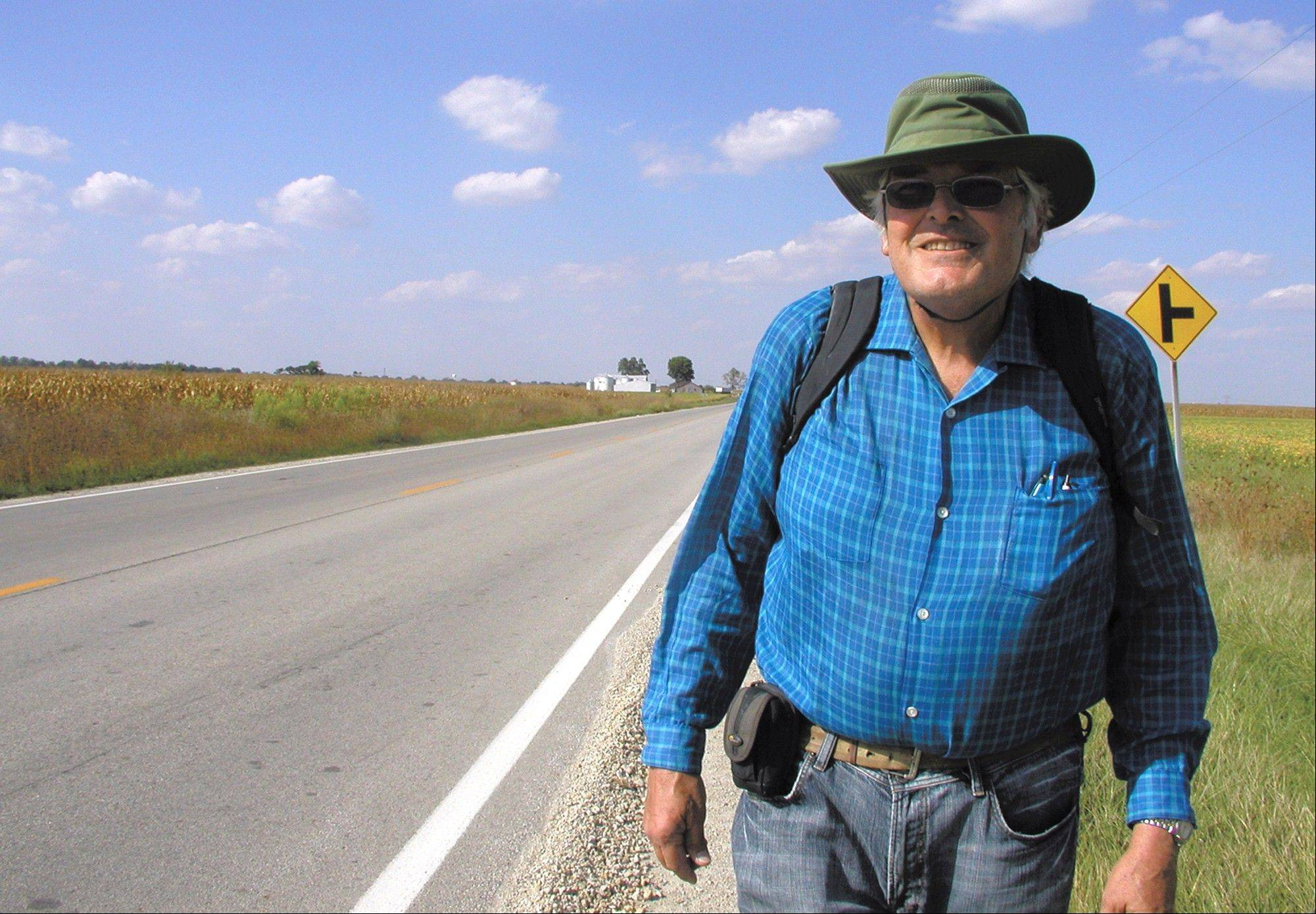 Retired anthropologist Bill Fairbanks heads south on Route 32 after making a brief stop in Stewardson, Ill. Fairbanks is walking cross-country to find out more about America's inhabitants and what drives them. He started his trip in California in 2009, and his final destination is Boston.
