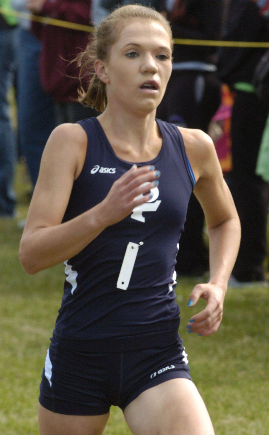 JOE LEWNARD/jlewnard@dailyherald.com Lake Park's Kaylee Flanagan wins the Palatine cross country invitational Saturday.