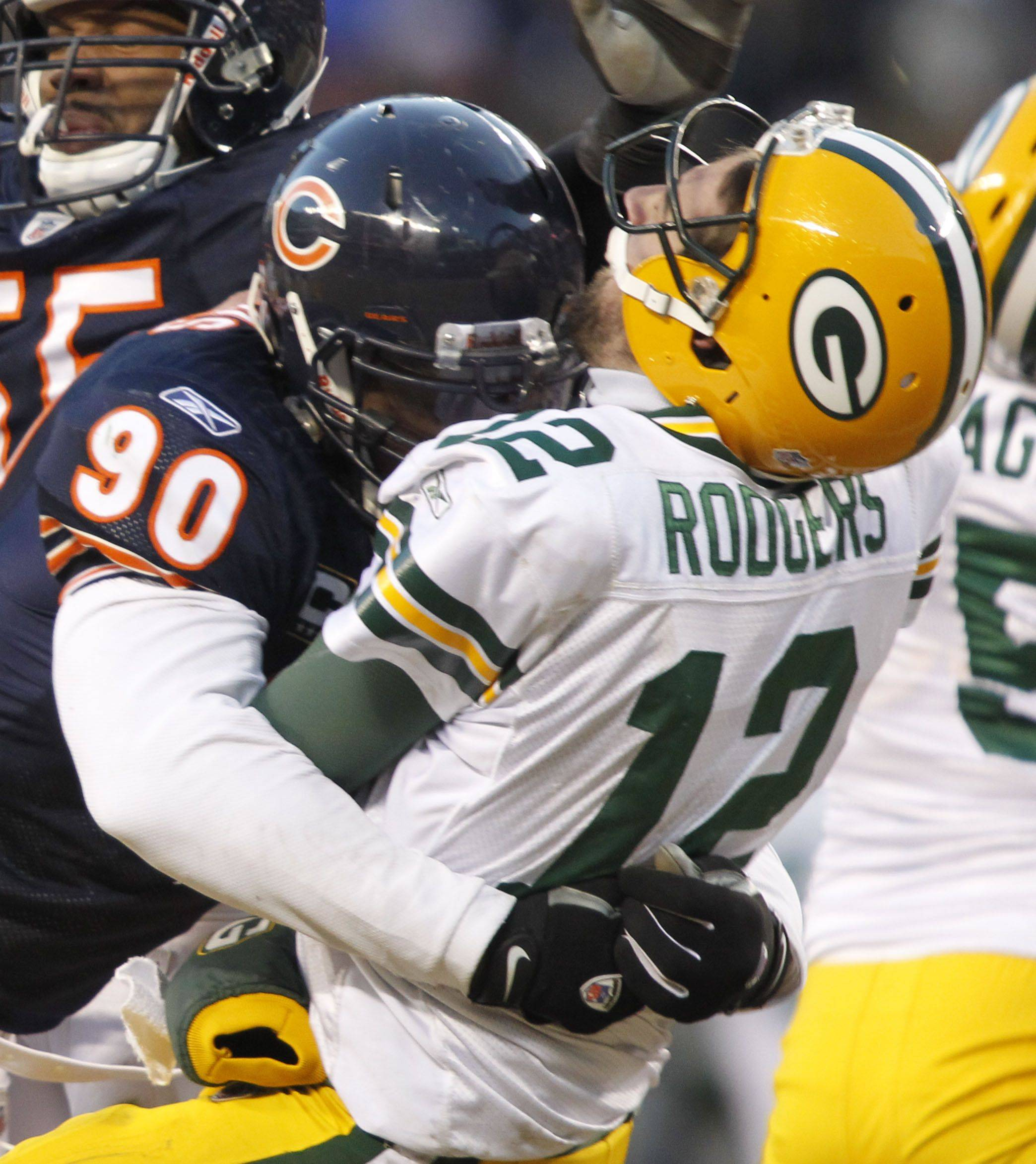 Chicago Bears defensive end Julius Peppers hits Green Bay Packers quarterback Aaron Rodgers during the NFC Championship game between the Chicago Bears and the Green Bay Packers Sunday at Soldier Field in Chicago.