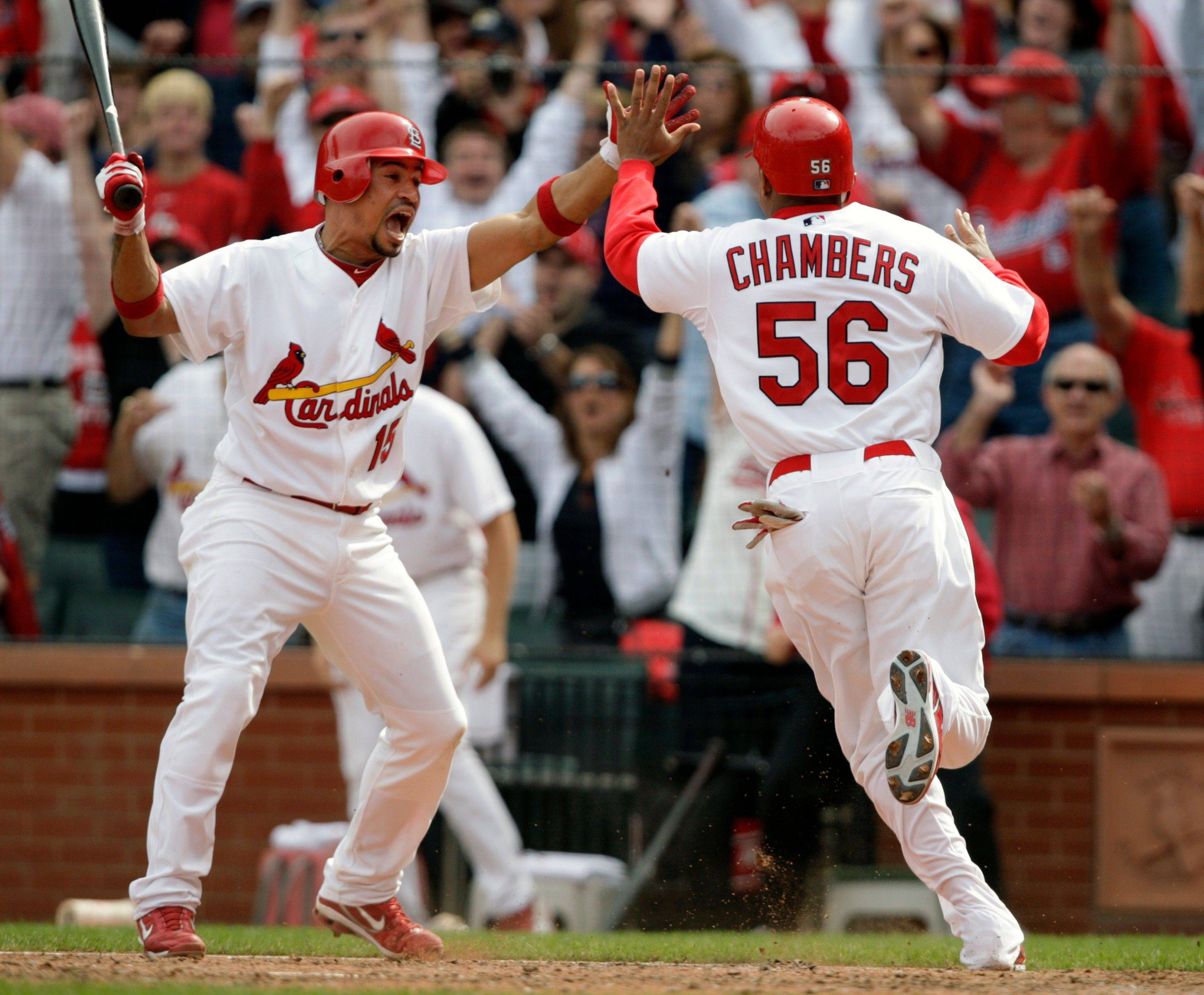 St. Louis Cardinals' Adron Chambers (56) celebrates with teammate Rafael Furcal as he scores the game-winning run from third on a wild pitch by Cubs relief pitcher Carlos Marmol in the ninth inning Saturday in St. Louis. Marmol also gave up the tying run on a bases-loaded walk.